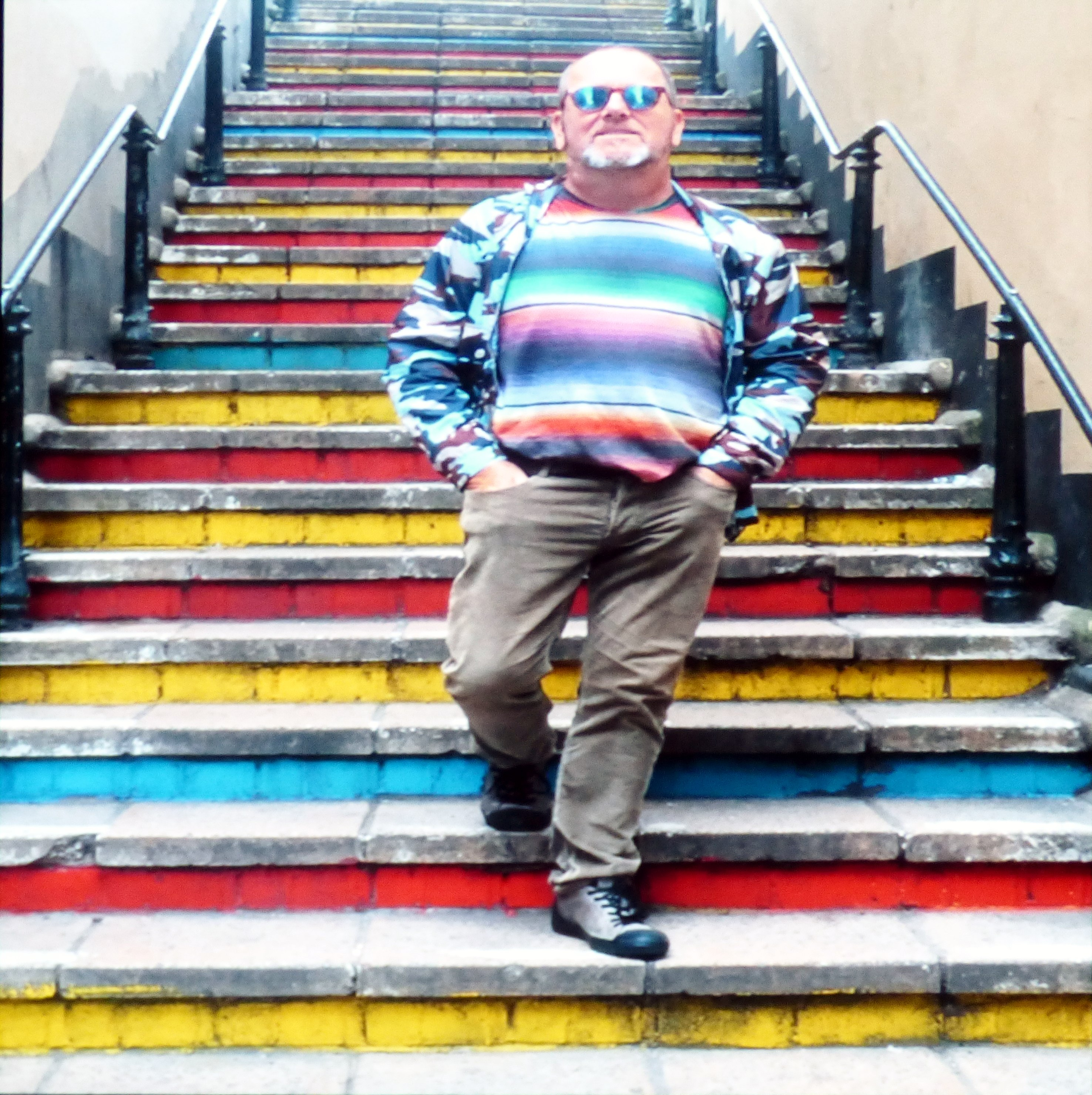 slide showing Brandon and some colourful steps at Kaffe Fassett Lecture, Capstone Theatre, Dec 2016