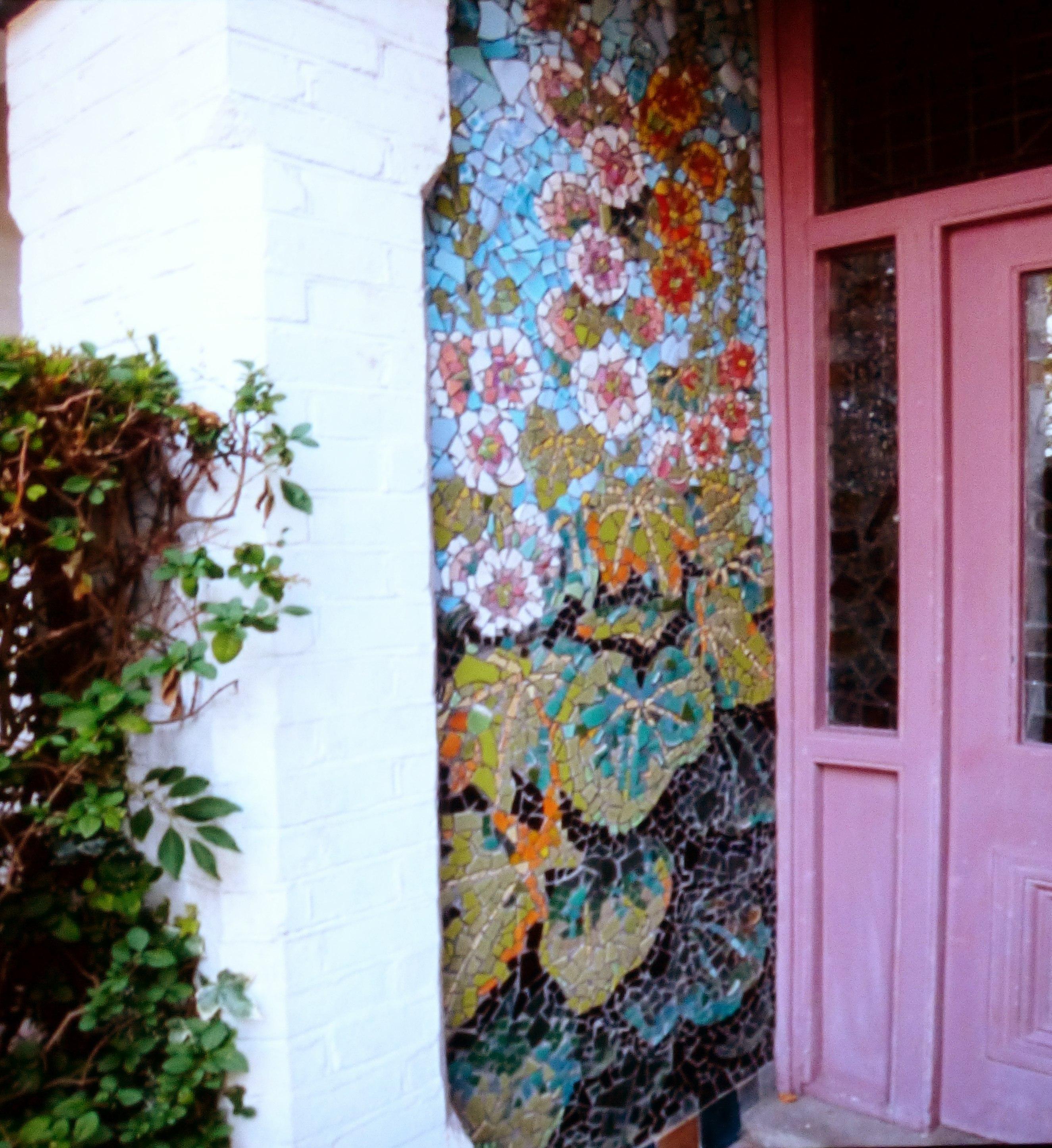 slide showing mosaic wall at Kaffe Fassett's home, Kaffe Fassett Lecture, Capstone Theatre, Dec 2016