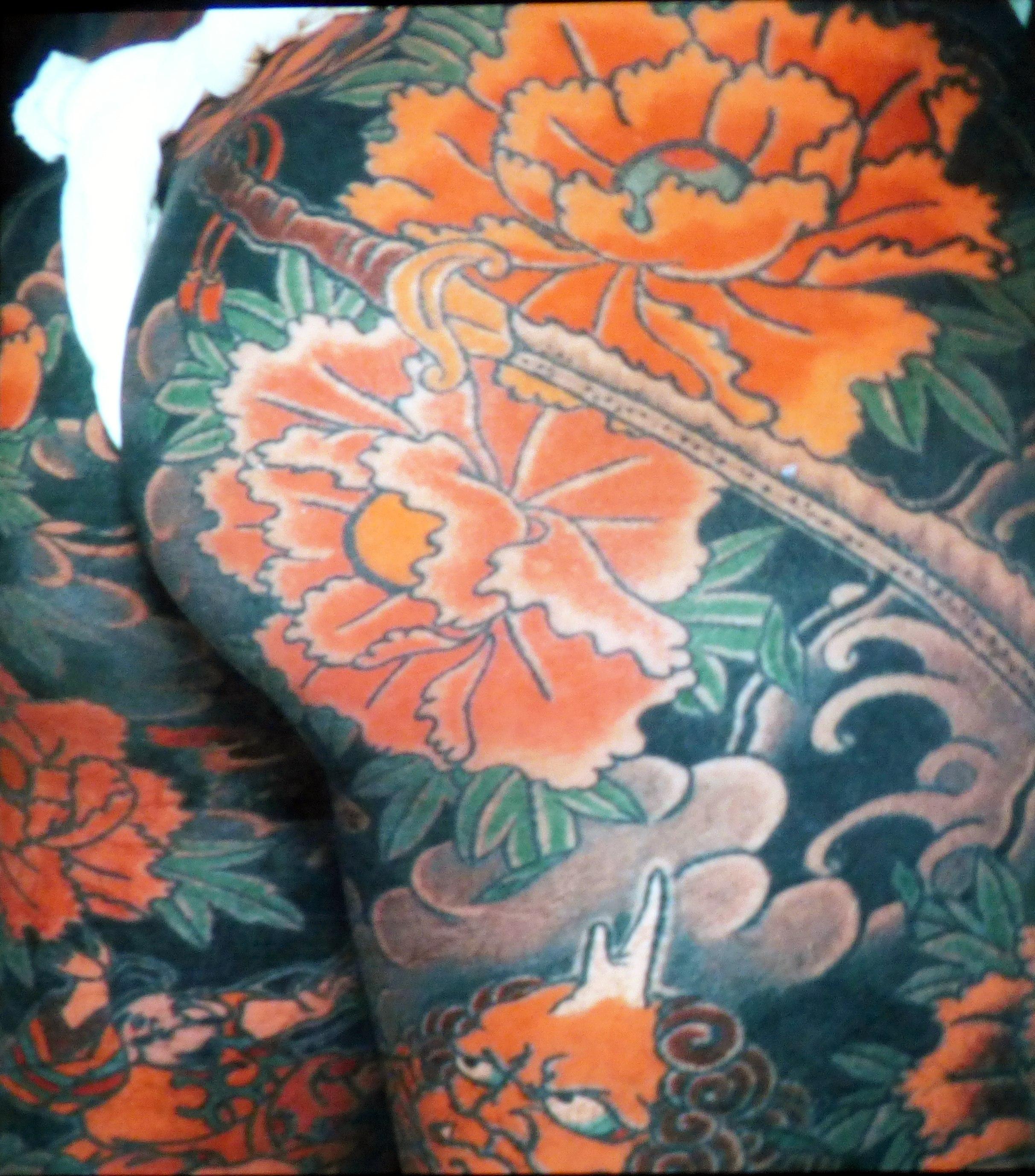 inspiration slide showing a tattooed torso, Kaffe Fassett Lecture, Capstone Theatre, Dec 2016