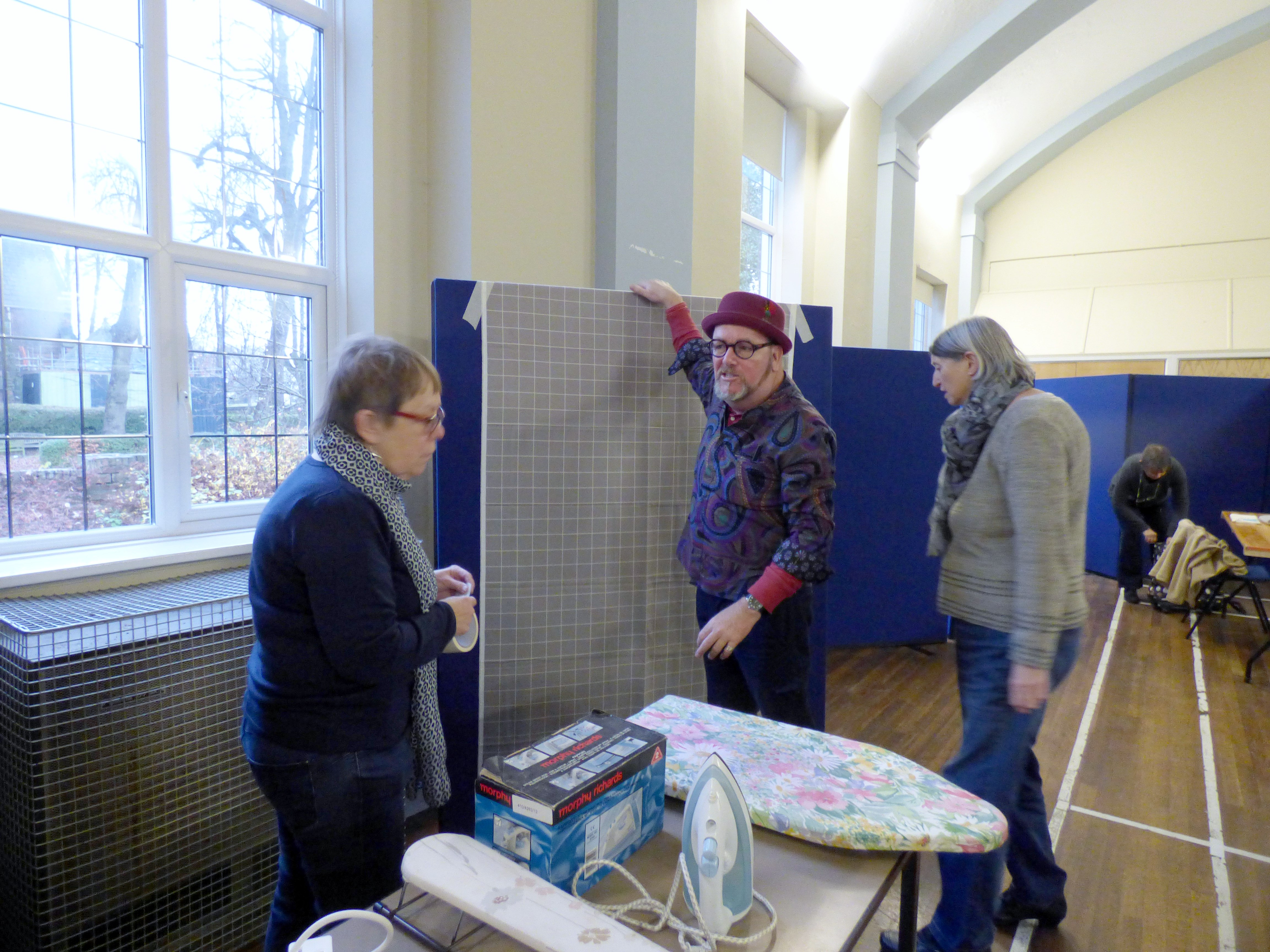 Brandon Mably is showing us how to attach the flannel to the design boards- Kaffe Fassett workshop, All Hallows, Dec 2016