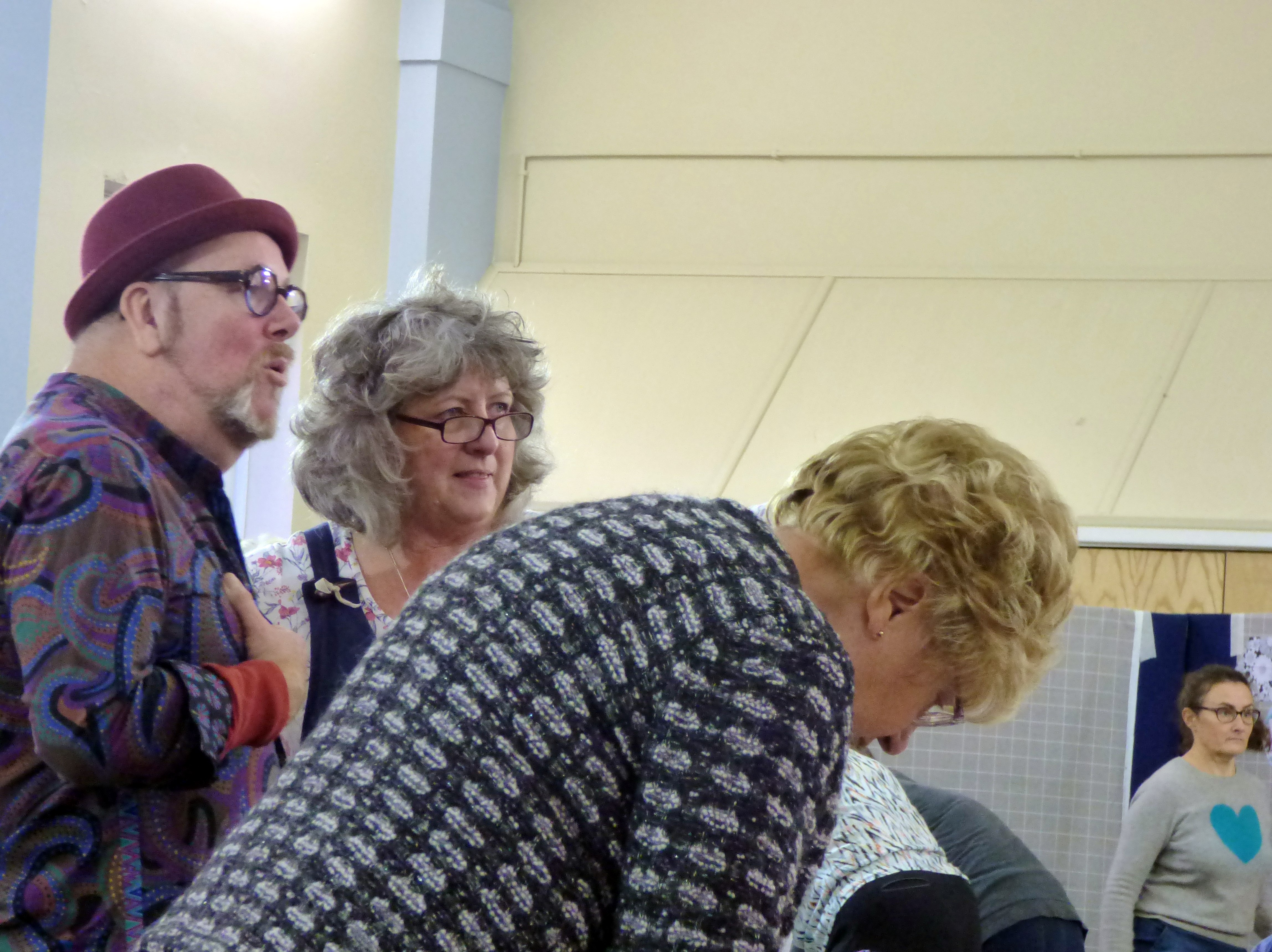 Brandon and Carol discussing design points- Kaffe Fassett workshop, All Hallows, Dec 2016