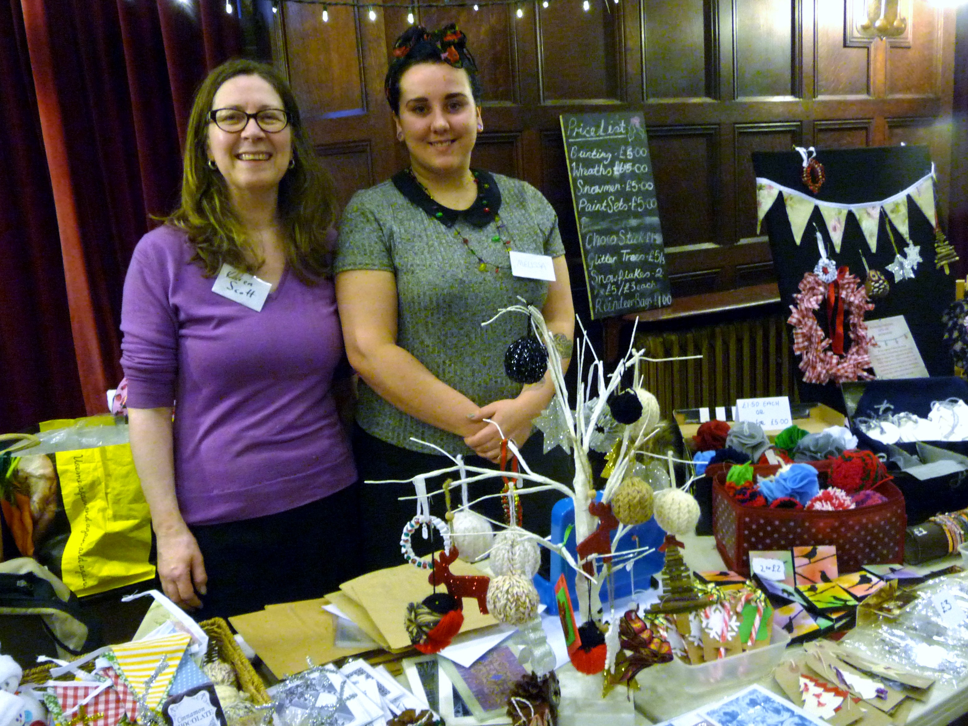 MEG Christmas Party 2015- Karen Scott and Melissa Courtney with their Hope University stall