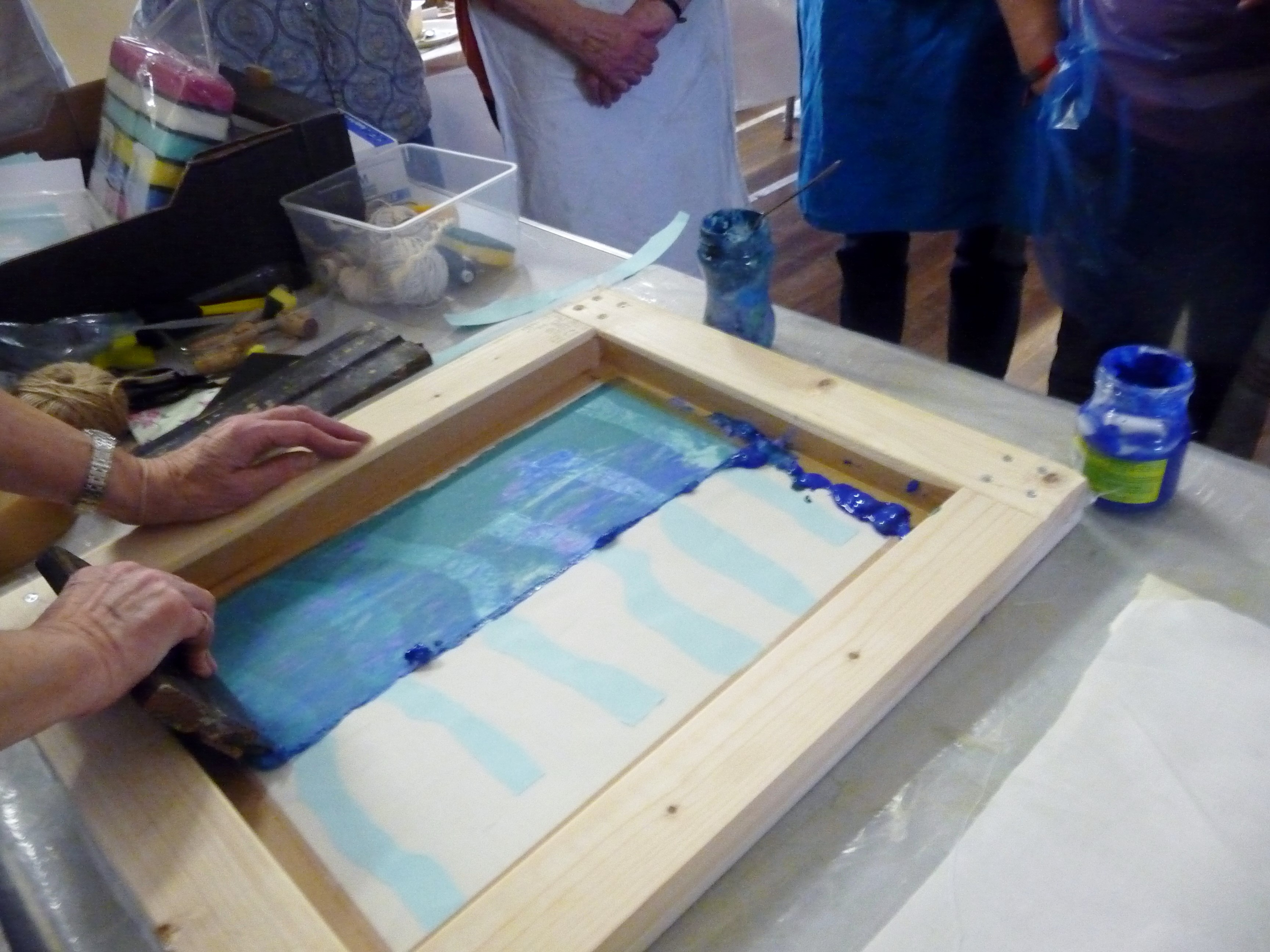"Elsie Watkins demonstrating screen printing at ""Lets Print"" workshop"