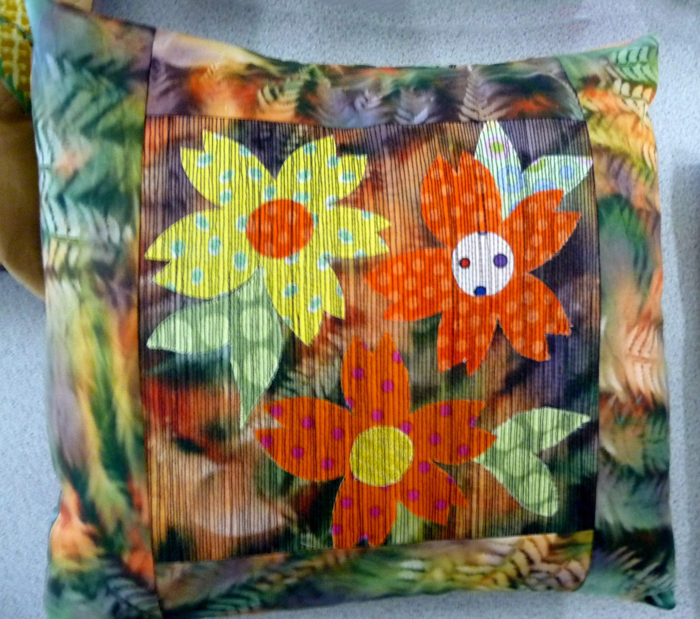 applique cushion with machine embroidery by Norma Heron