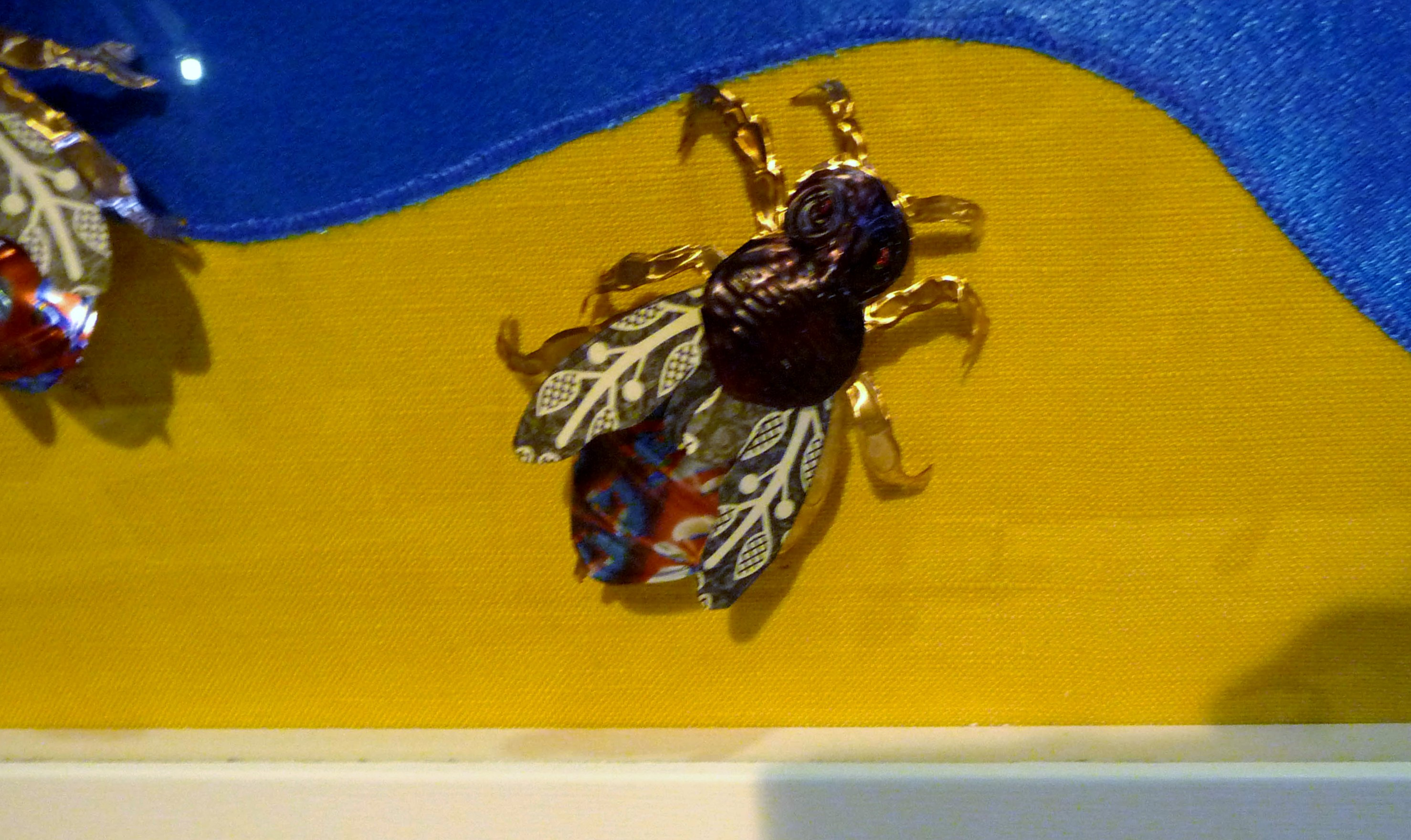 """(detail) 3D """"Bees"""" by Janet Wilkinson, mixed media. printed foil"""