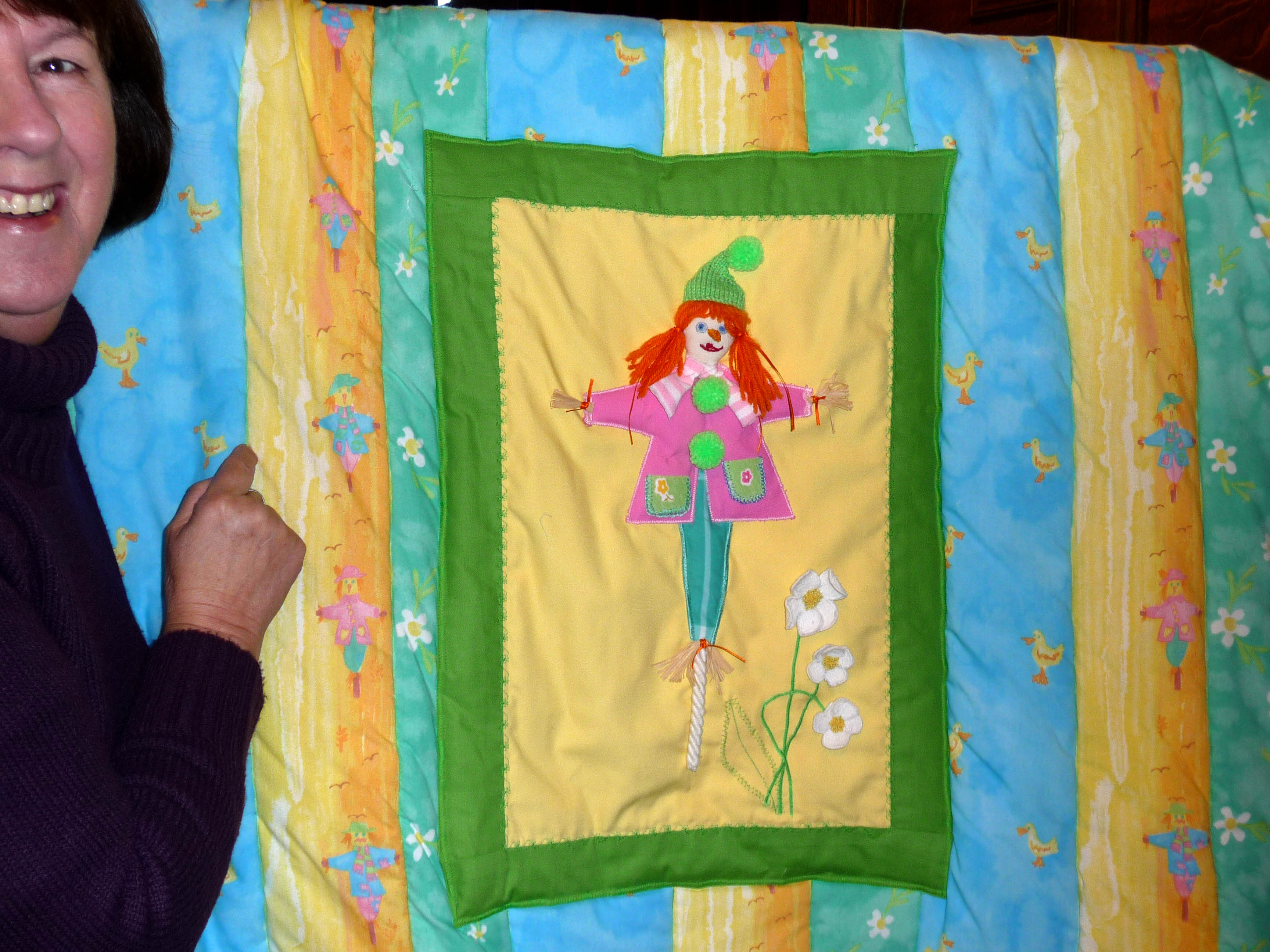 Jean Critchley and her applique quilt, an entry to the Tradioional Embroidery Competition 2013