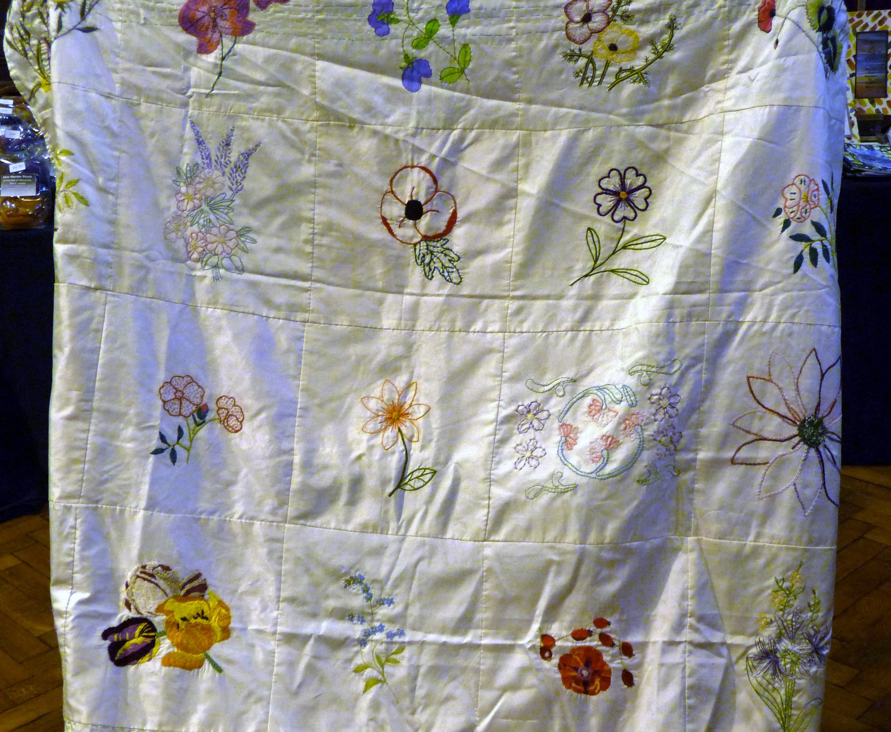this is an embroidered silk quilt which will be raffled for Sreepur Women's Refuge and Orphanage Charity