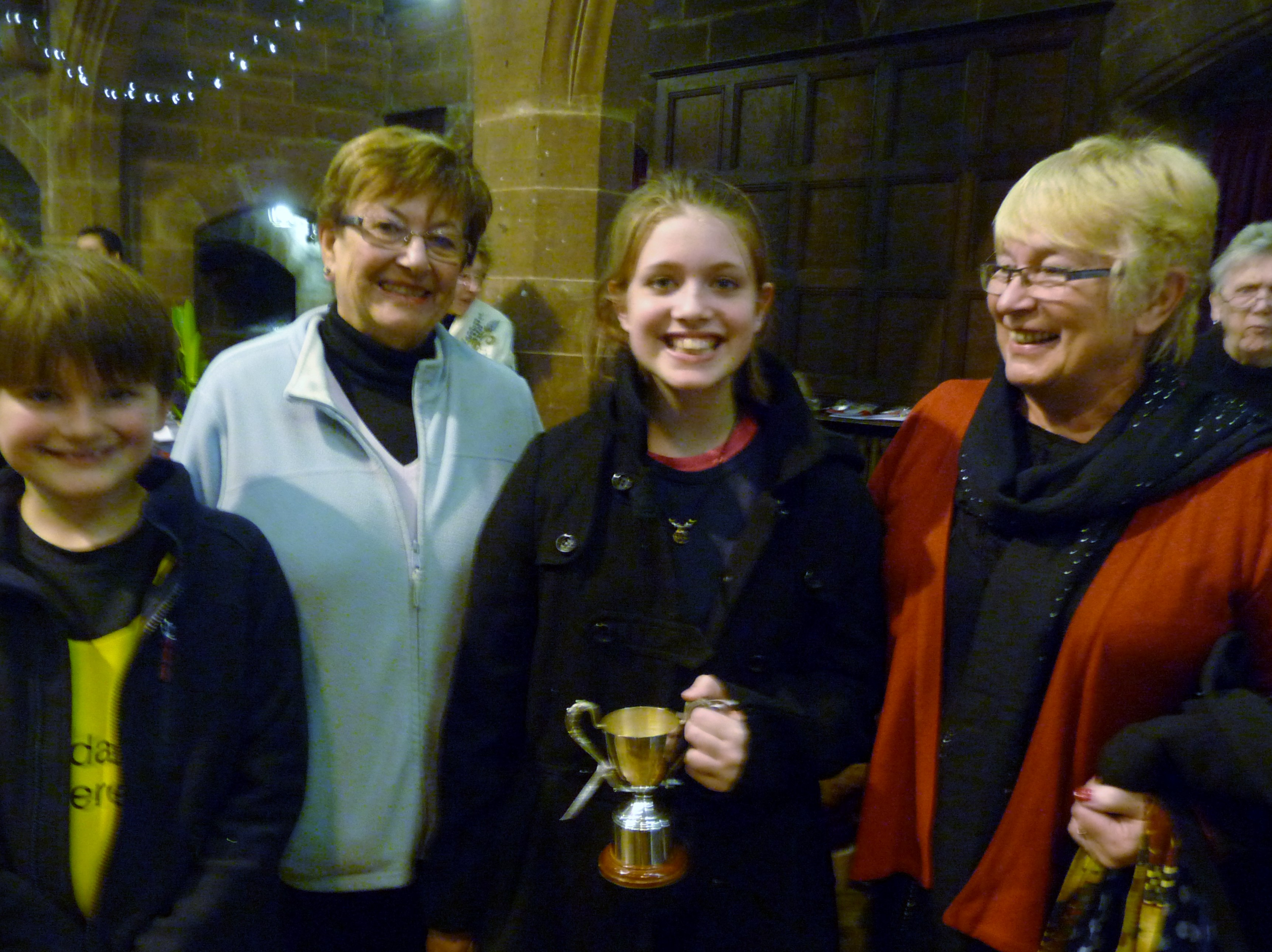 Maisie with her family after receiving her award - Merseyside Young Embroiderer of the Year 2013