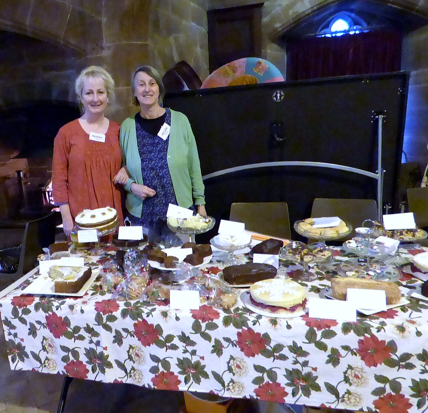 Sarah and Helen with the wonderful homemade cake stall at MEG Christmas Party 2017