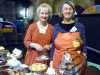 Sarah and Helen ready to welcome customers at the homemade cake stall, MEG Christmas Party 2017