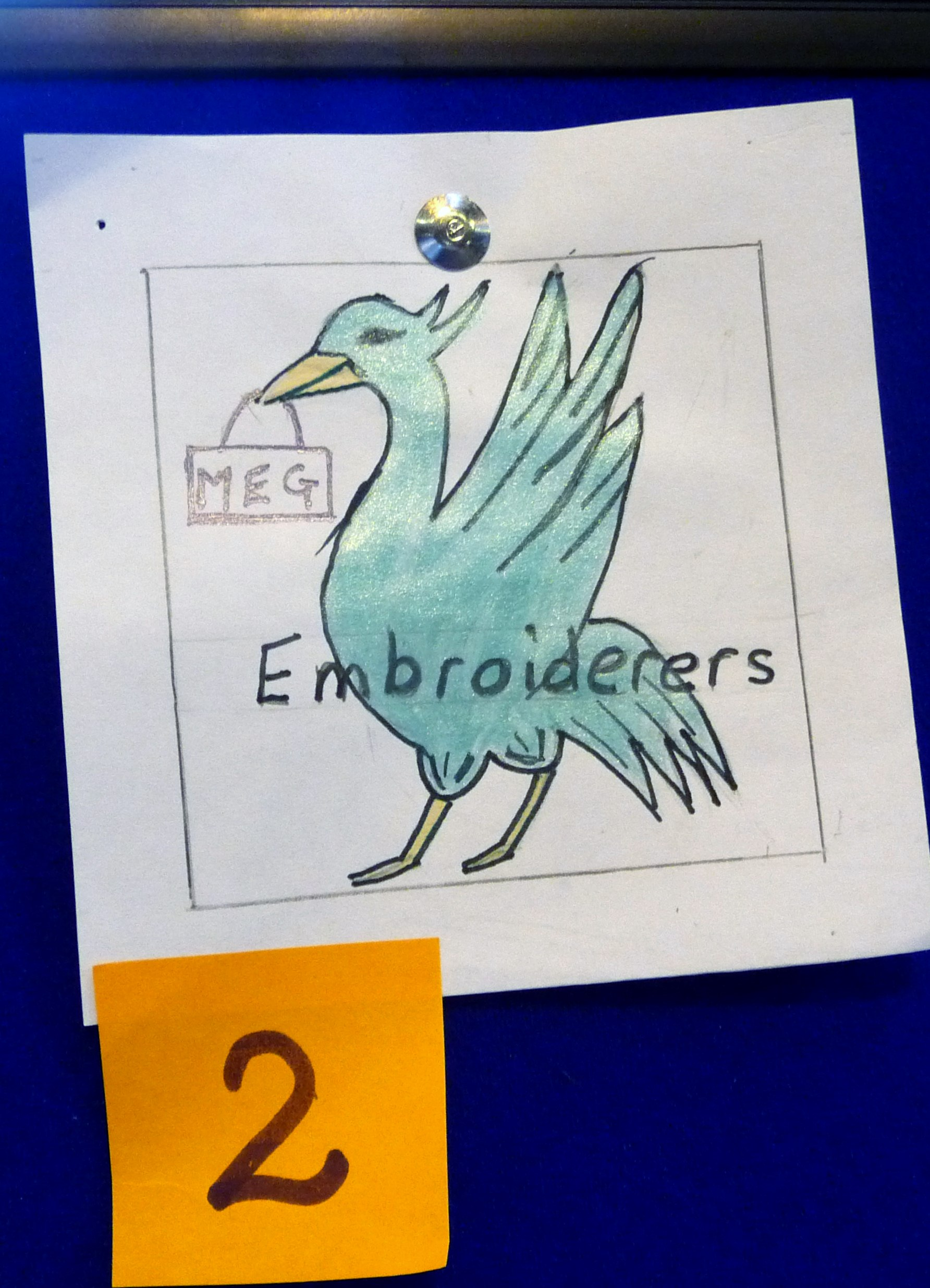 entry by Val Heron and winner of  MEG LOGO comp at Summer Tea Party 2015