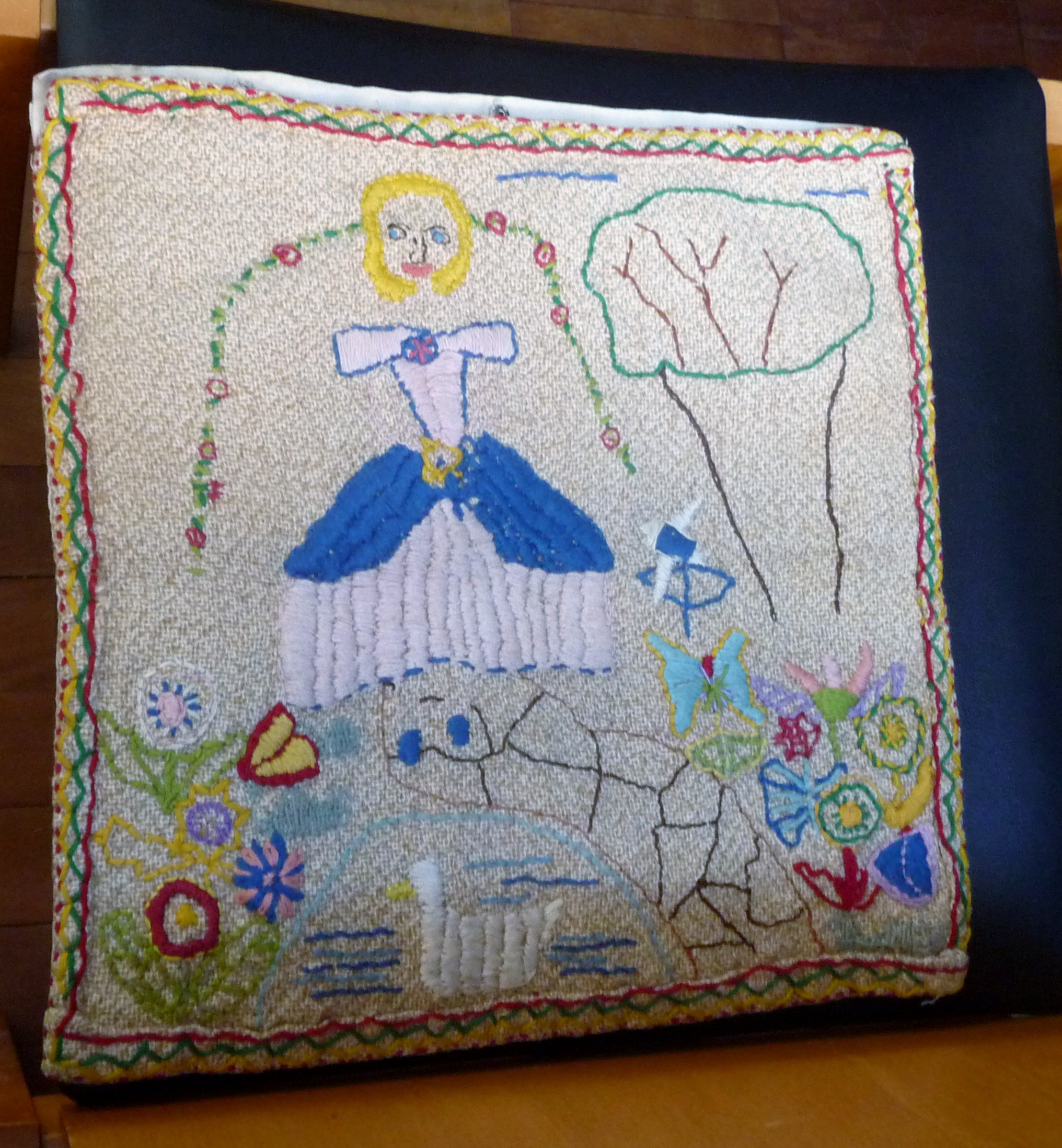 embroidery by Elsie Watkins, made at school