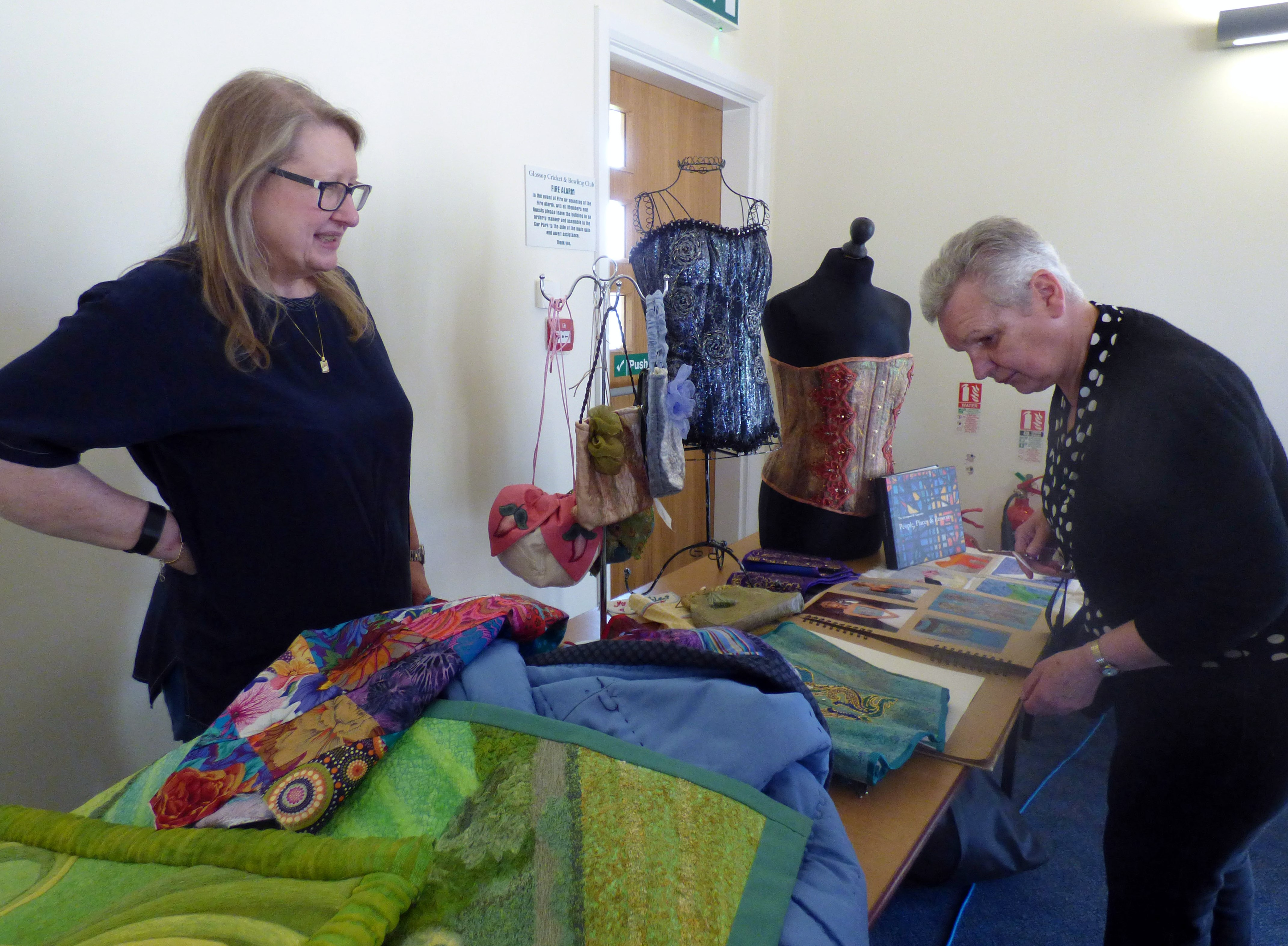 Gill Roberts showing her textiles to a member of Glossop EG, May 2017