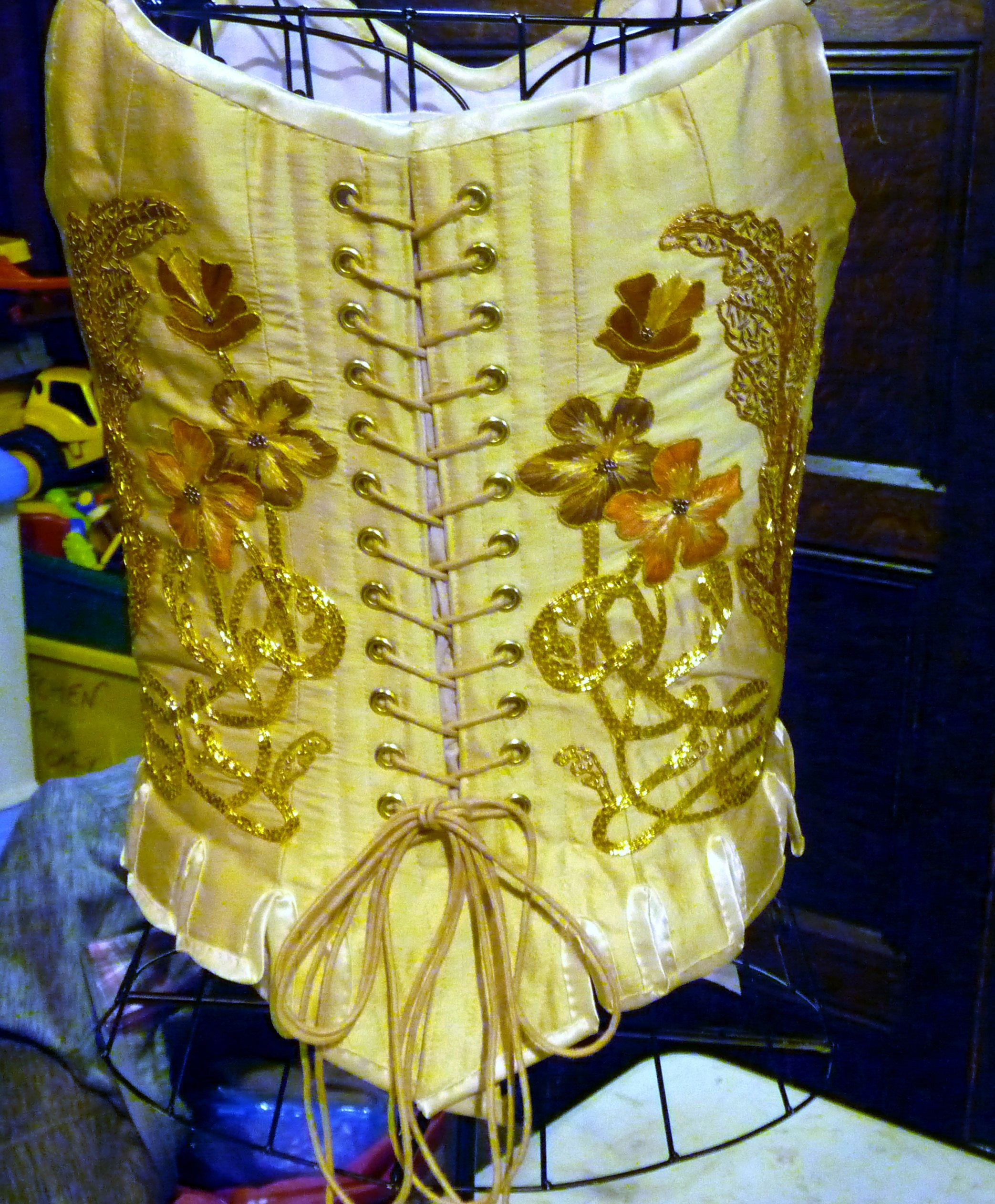 MEG Christmas Party 2015- back view of the winning entry to the Traditional Embroidery competition. Goldwork corset by Gill Roberts