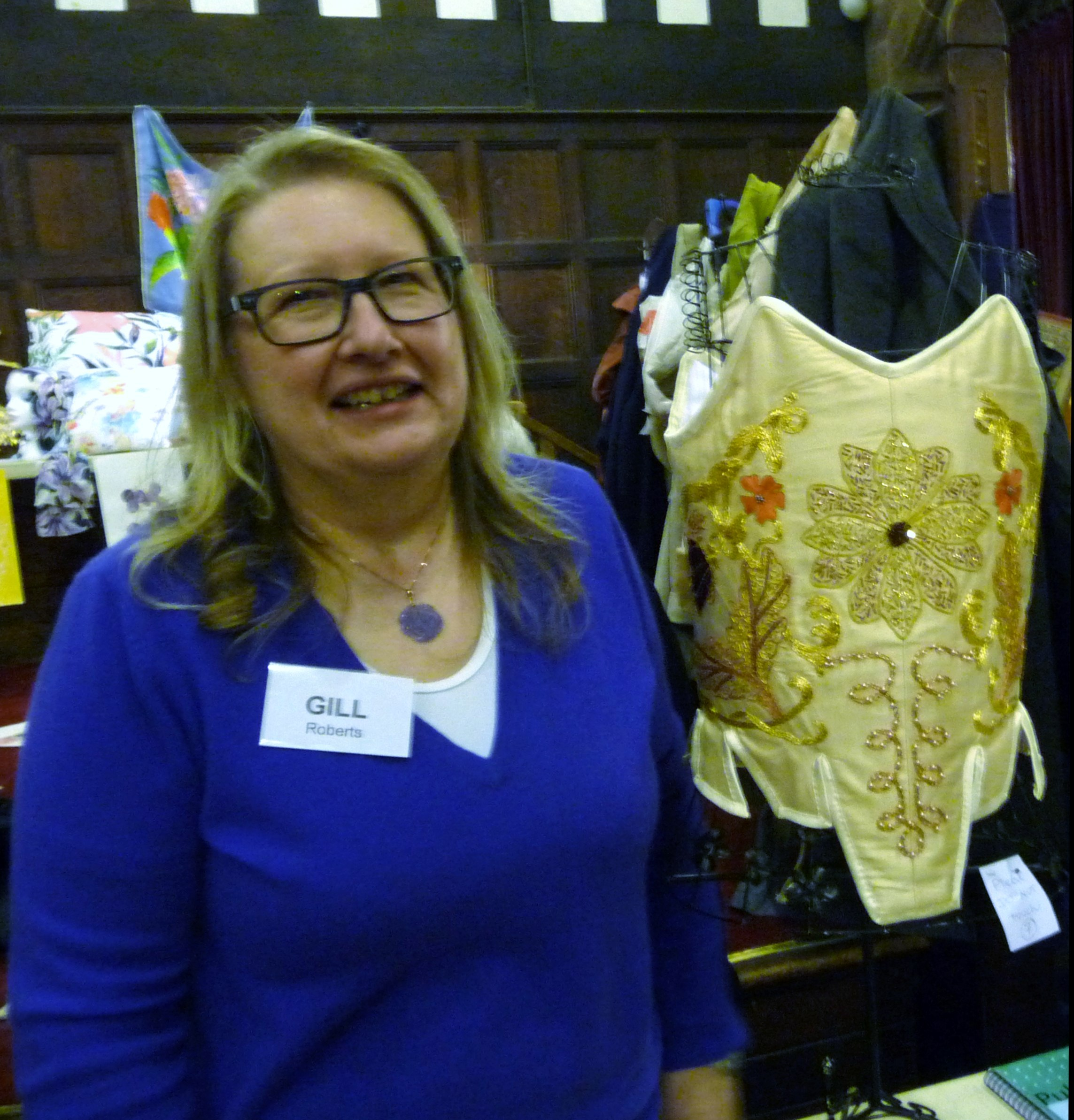 MEG Christmas Party 2015- Gill Roberts with her goldwork corset which won First Prize in the Traditional Embroidery competition