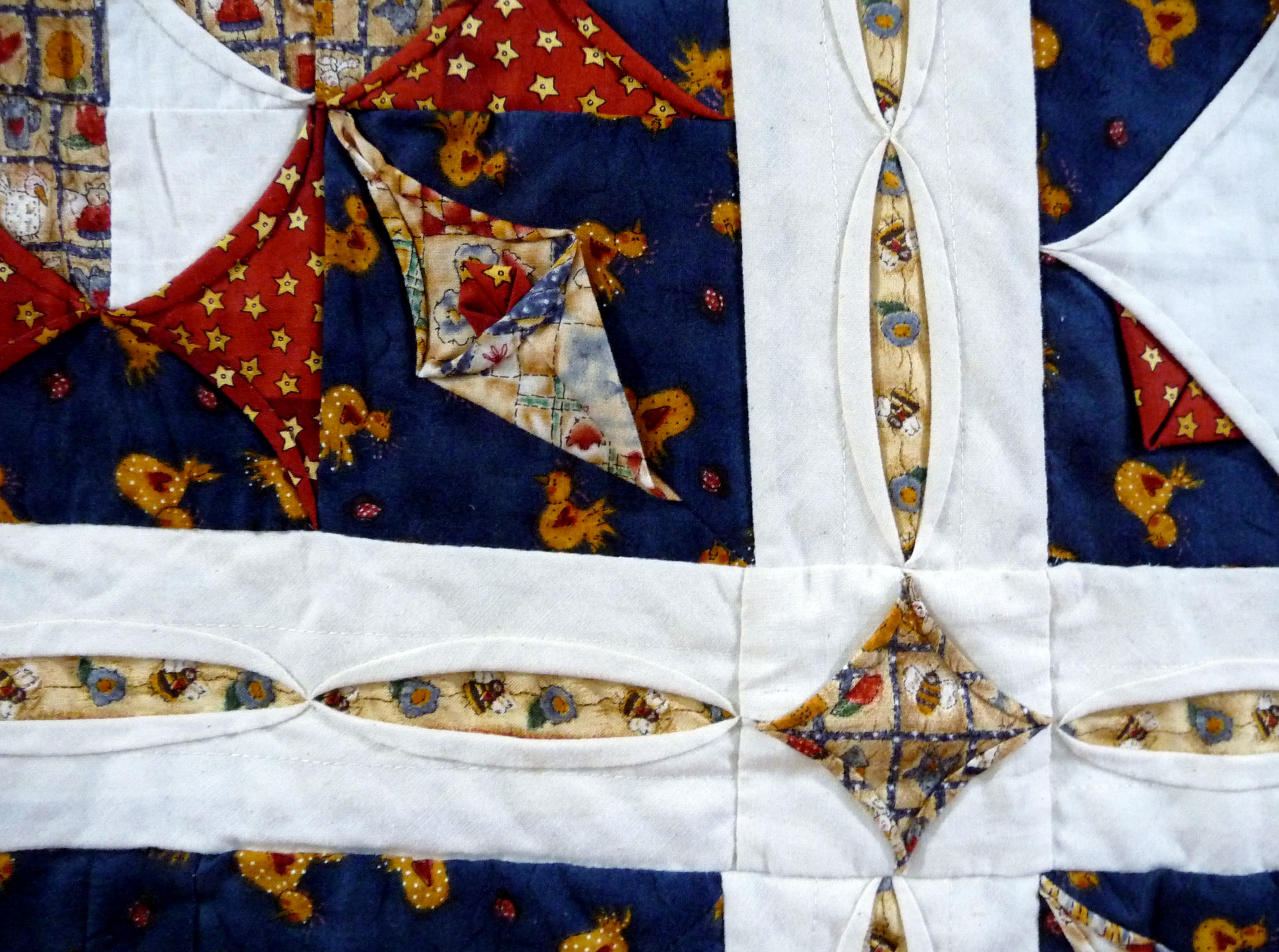 (detail) TUCKS & TEXTURES by Jenny Sheen, hand pieced quilt, machine quilted