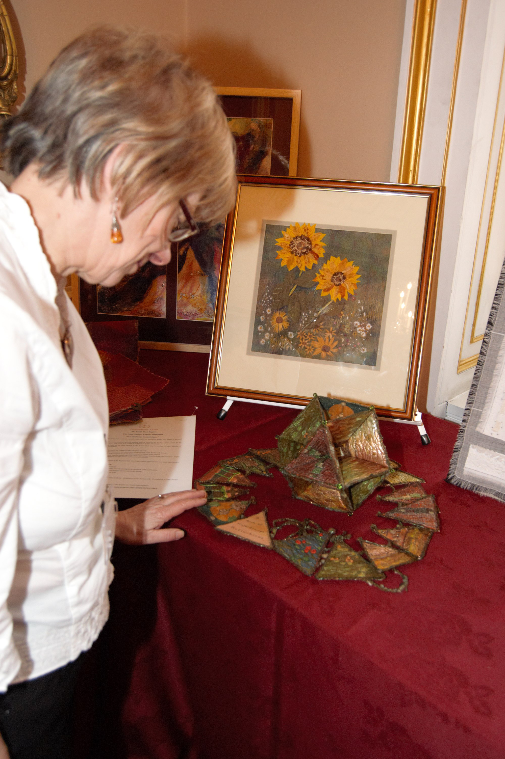 Elspeth admires an embroidery at NW Regional Day 2008 in Liverpool Town Hall