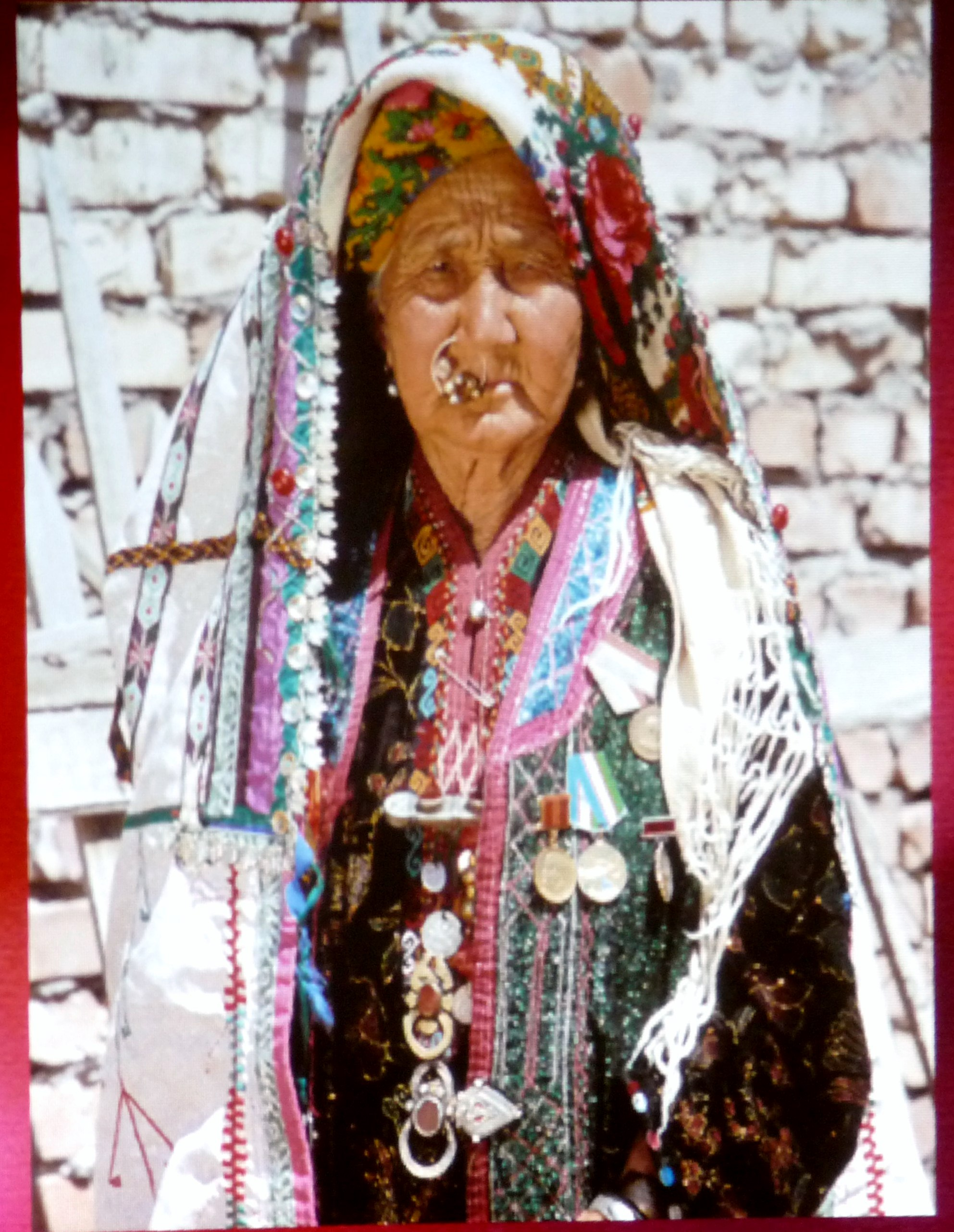 one of the Qaraqalpaq women wearing traditional embroidered clothing