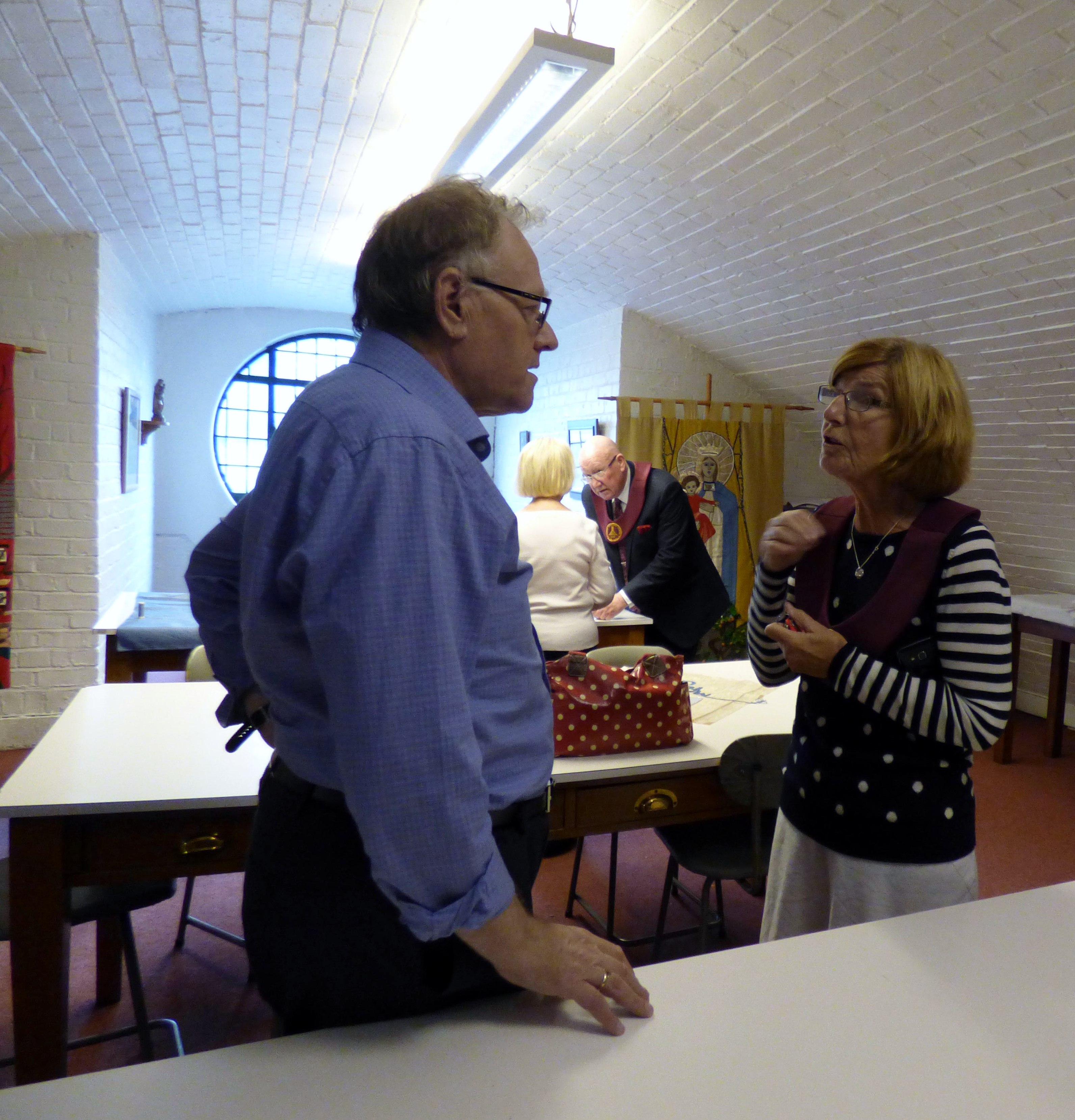 David Peglar, Embroidery Studio director with visitors to studio open day, L:iverpool Metropolitan Cathedral 2017