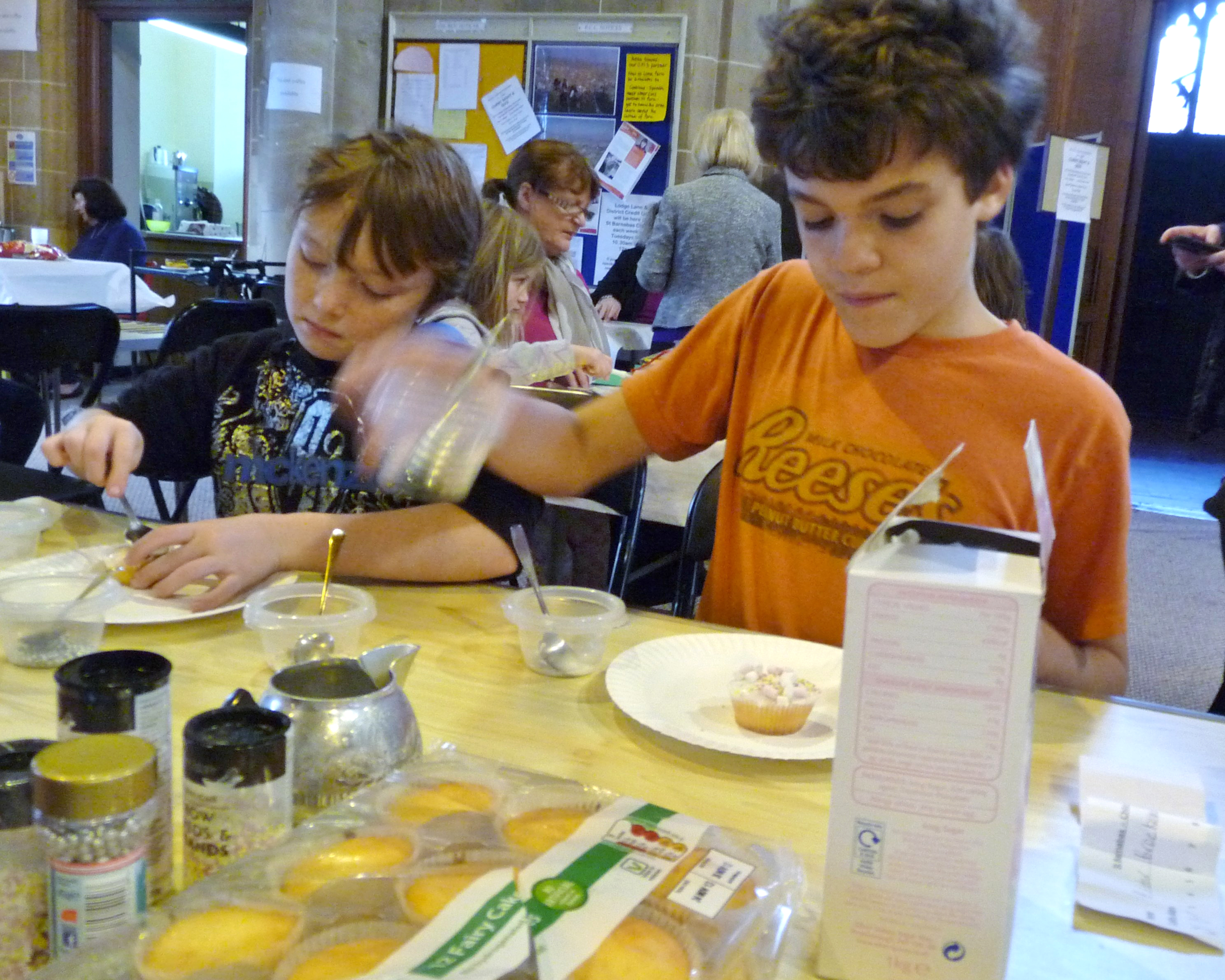 Cake icing at children's craft afternoon in St. Barnabus Church