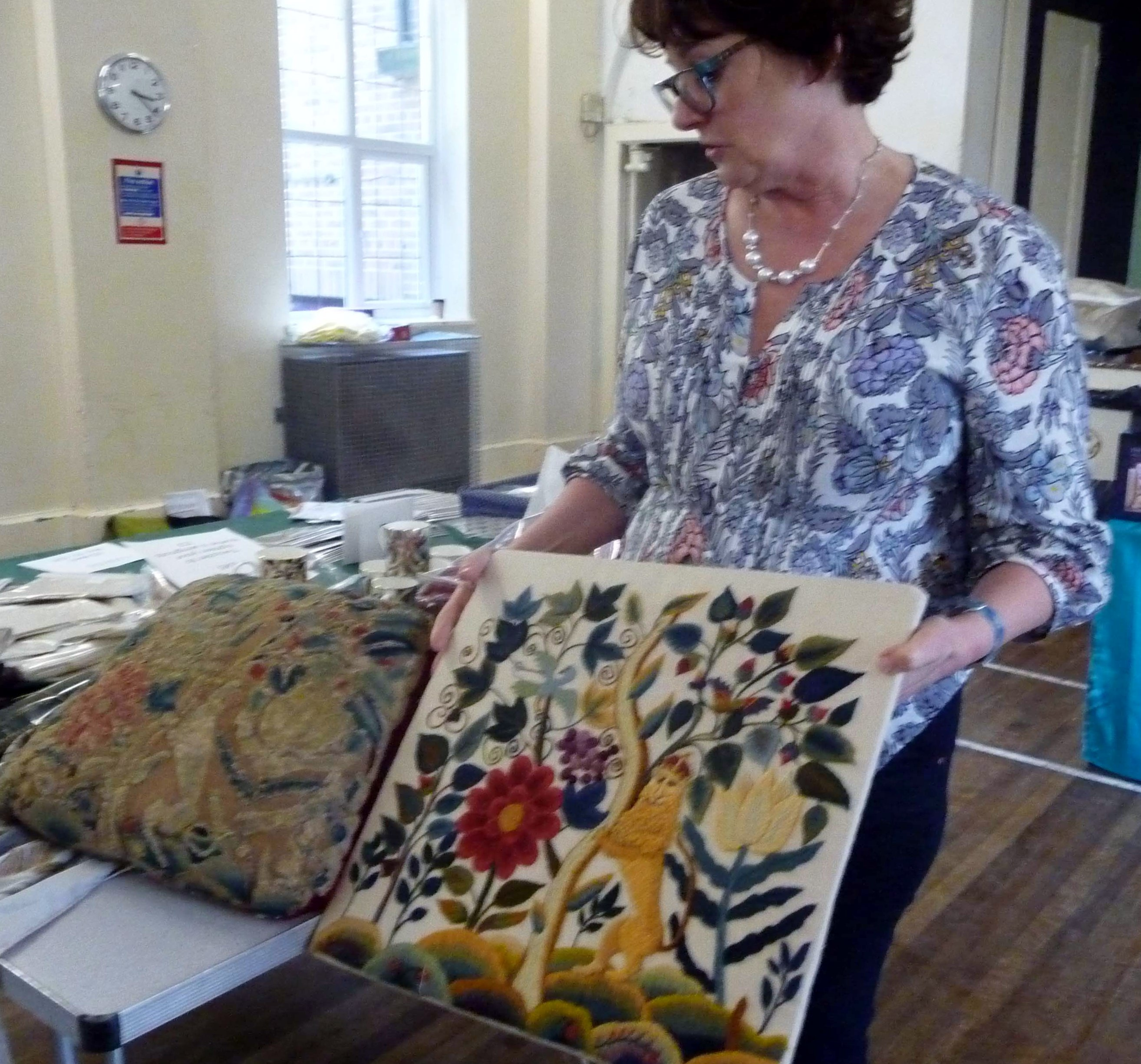 Phillipa Turnbull showing us an original embroidery and its reproduction