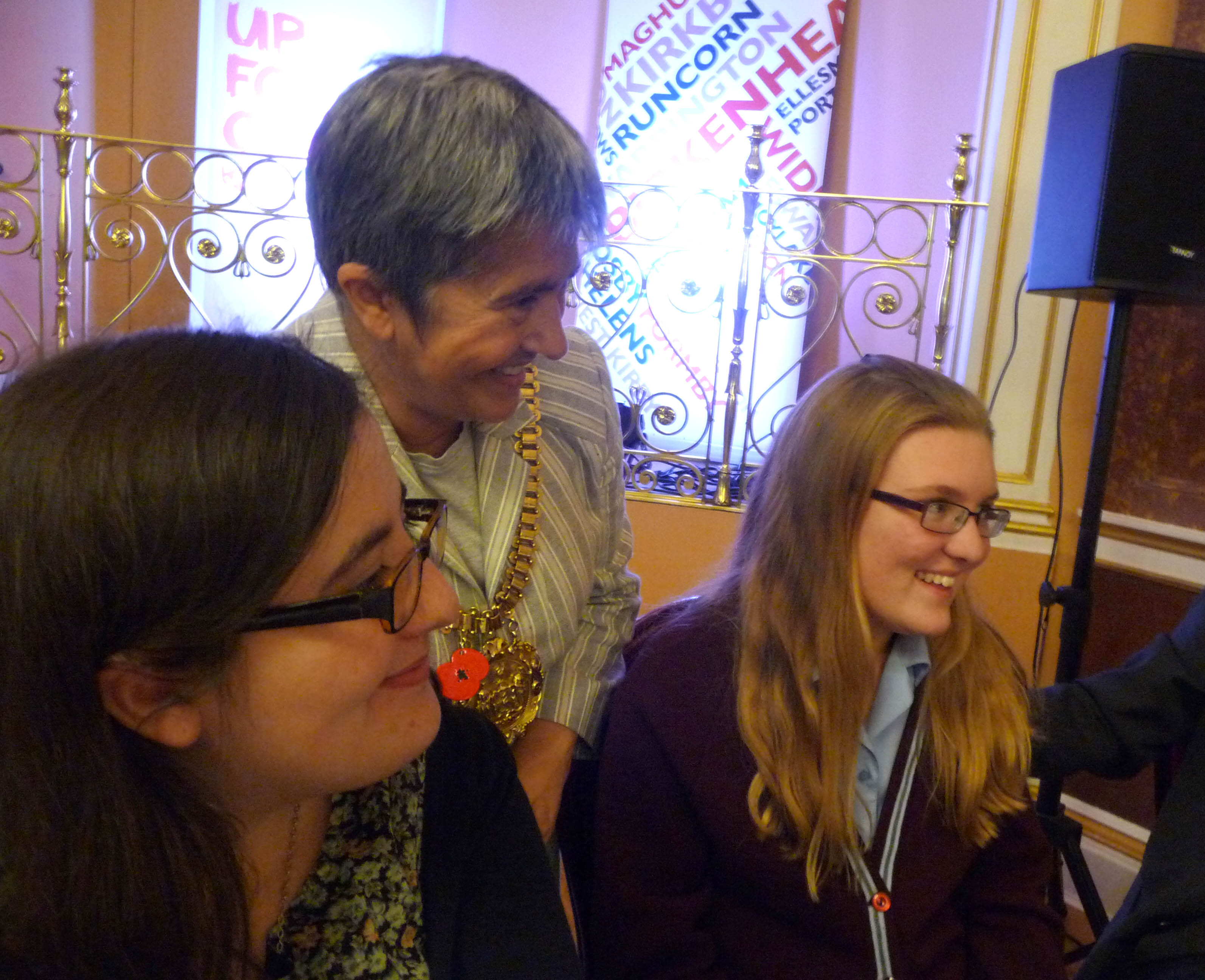 """Liverpool Lord Mayor Erica Kemp with Sophie and Chloe at the tea party in Liverpool Town hall to launch """"Posting to the Past"""" postcard exhibition, Nov 2014"""