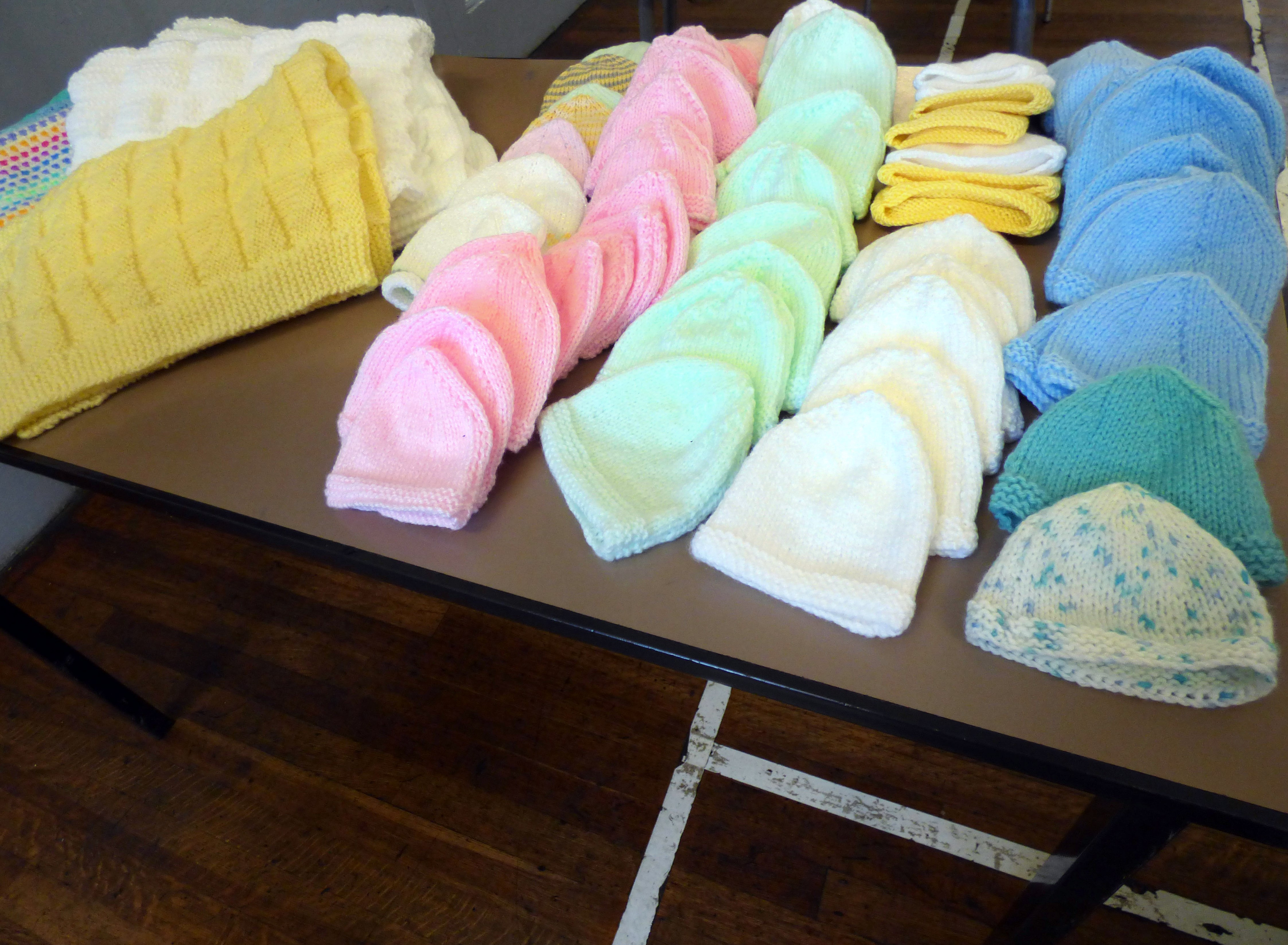 donation of knitted hats and blankets to Project Linus from MEG members and friends