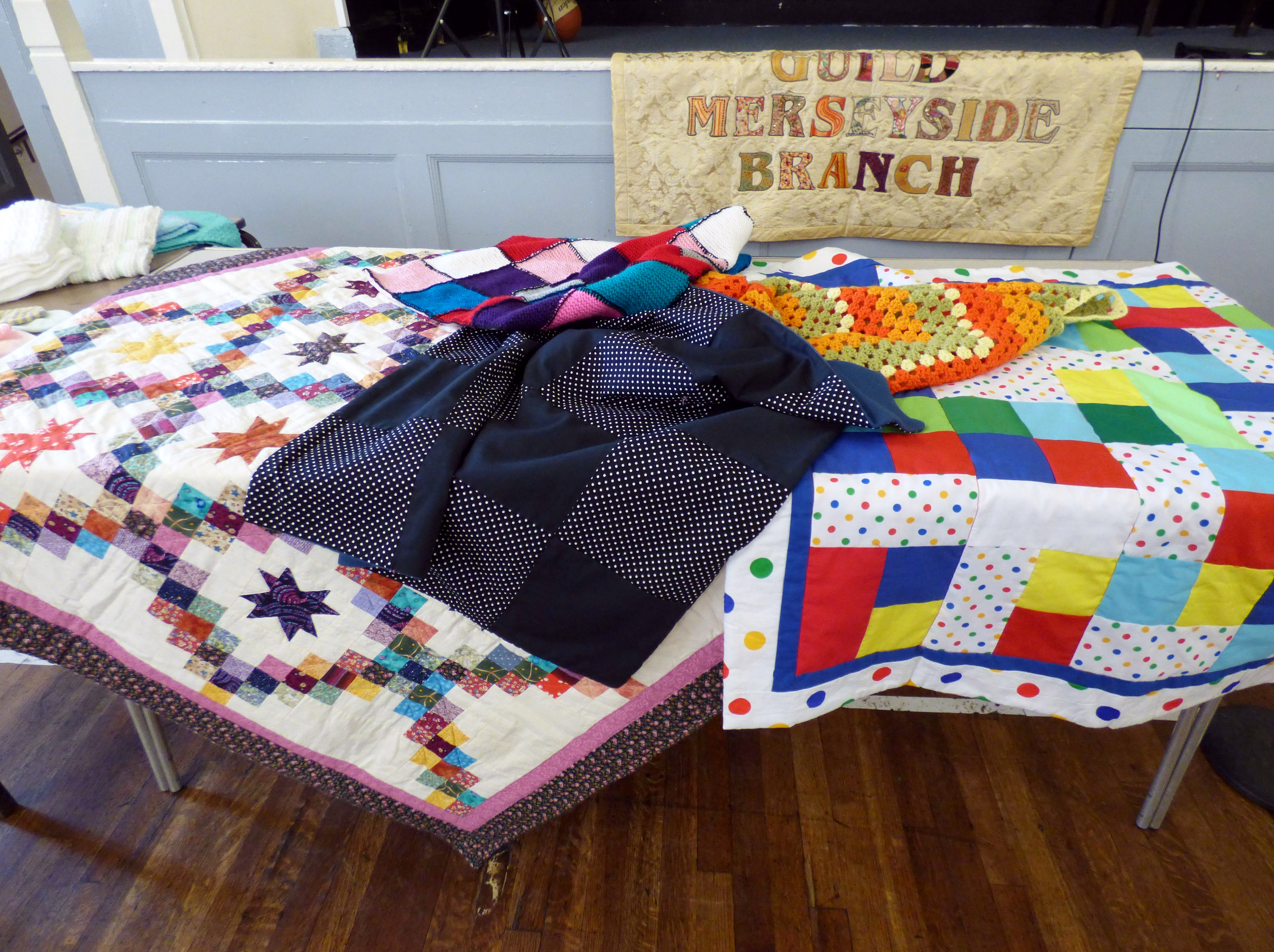 donated quilts and blankets at Talk by Caroline Fogell from Project Linus