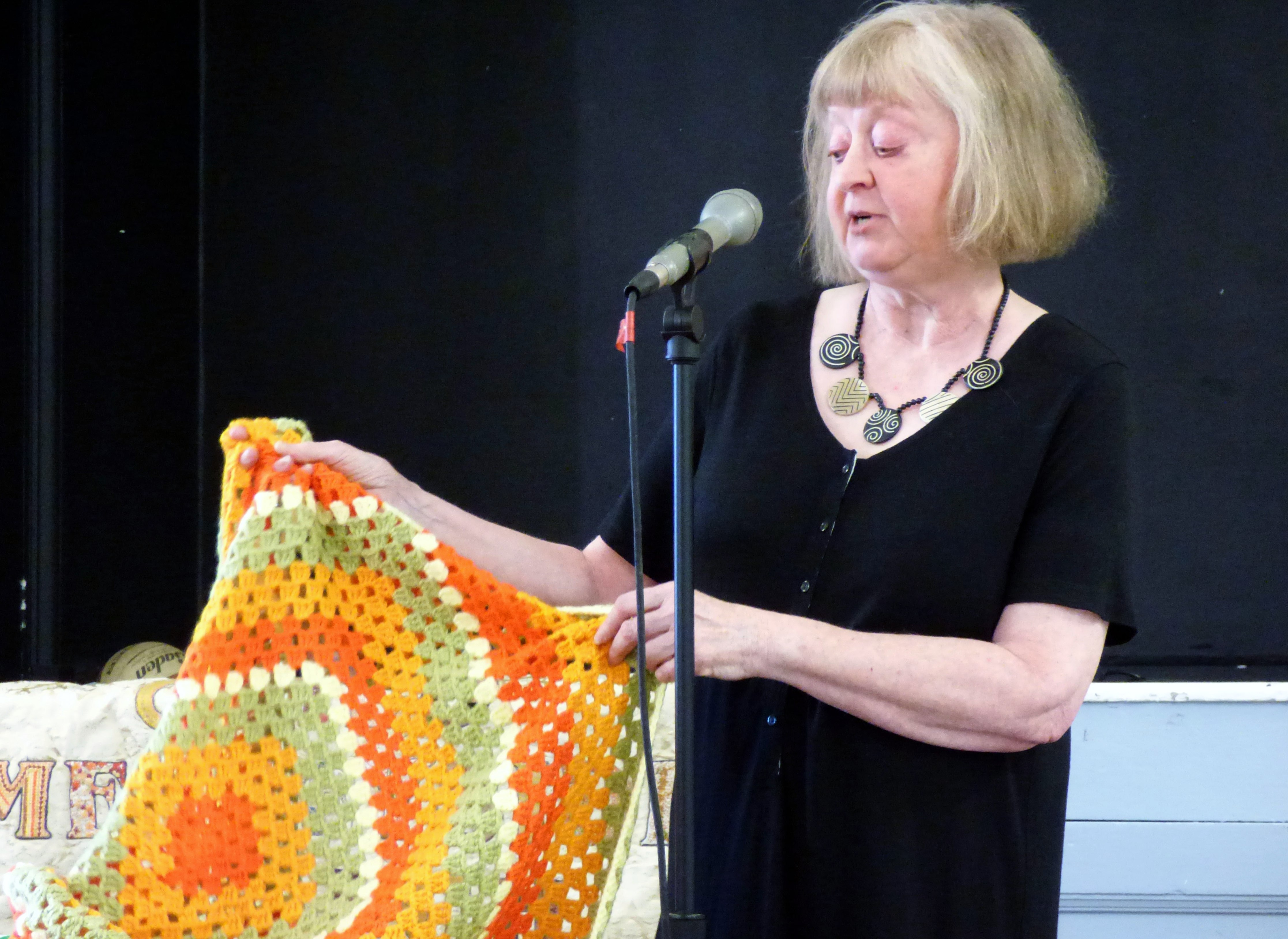 Caroline Fogell with a crochet blanket at Talk by Caroline Fogell from Project Linus