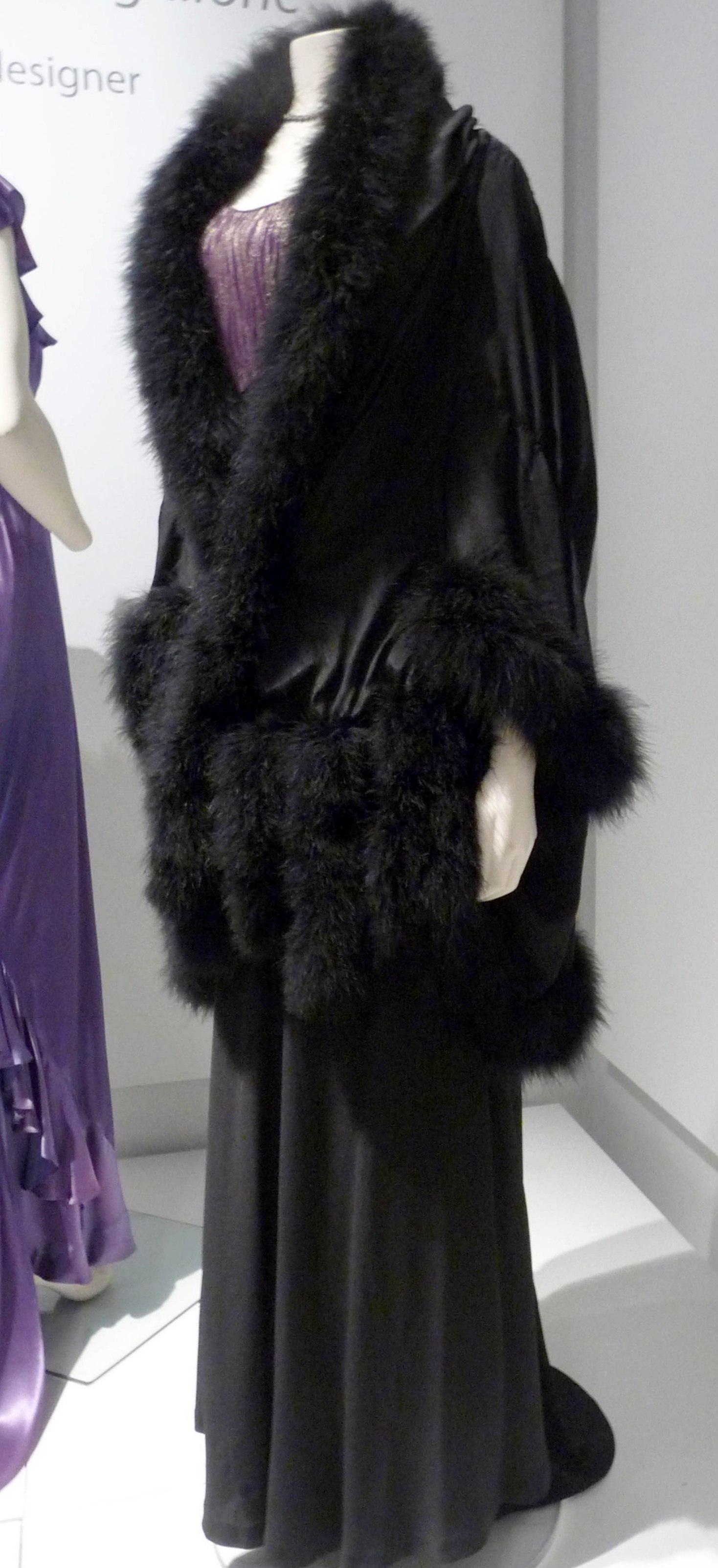 Evening dress, silk crepe & lurex, 1934-38. Evening mantle, silk crepe-de-chine & marabou feathers, 1930
