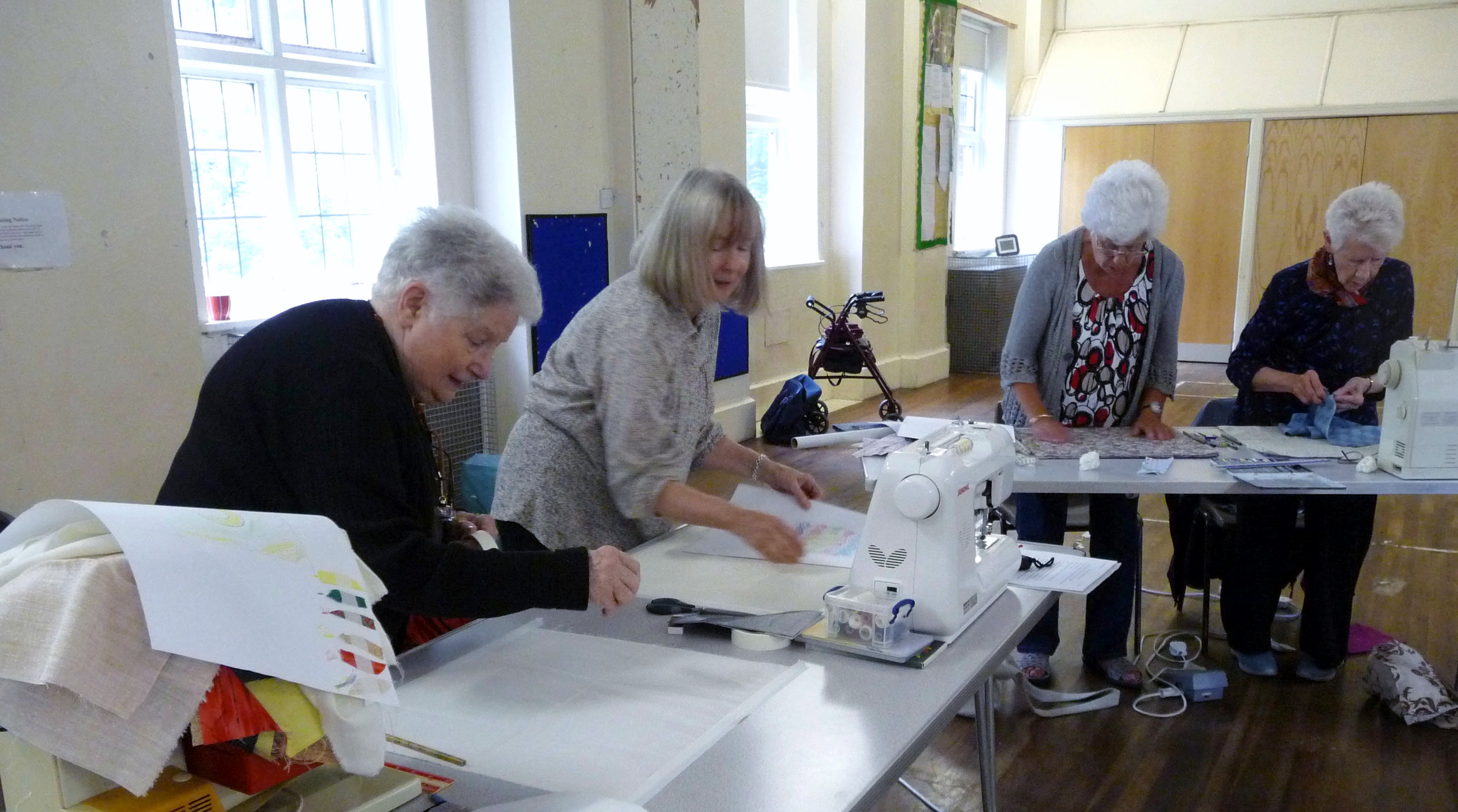 some of the group layering the fabrics for reverse applique