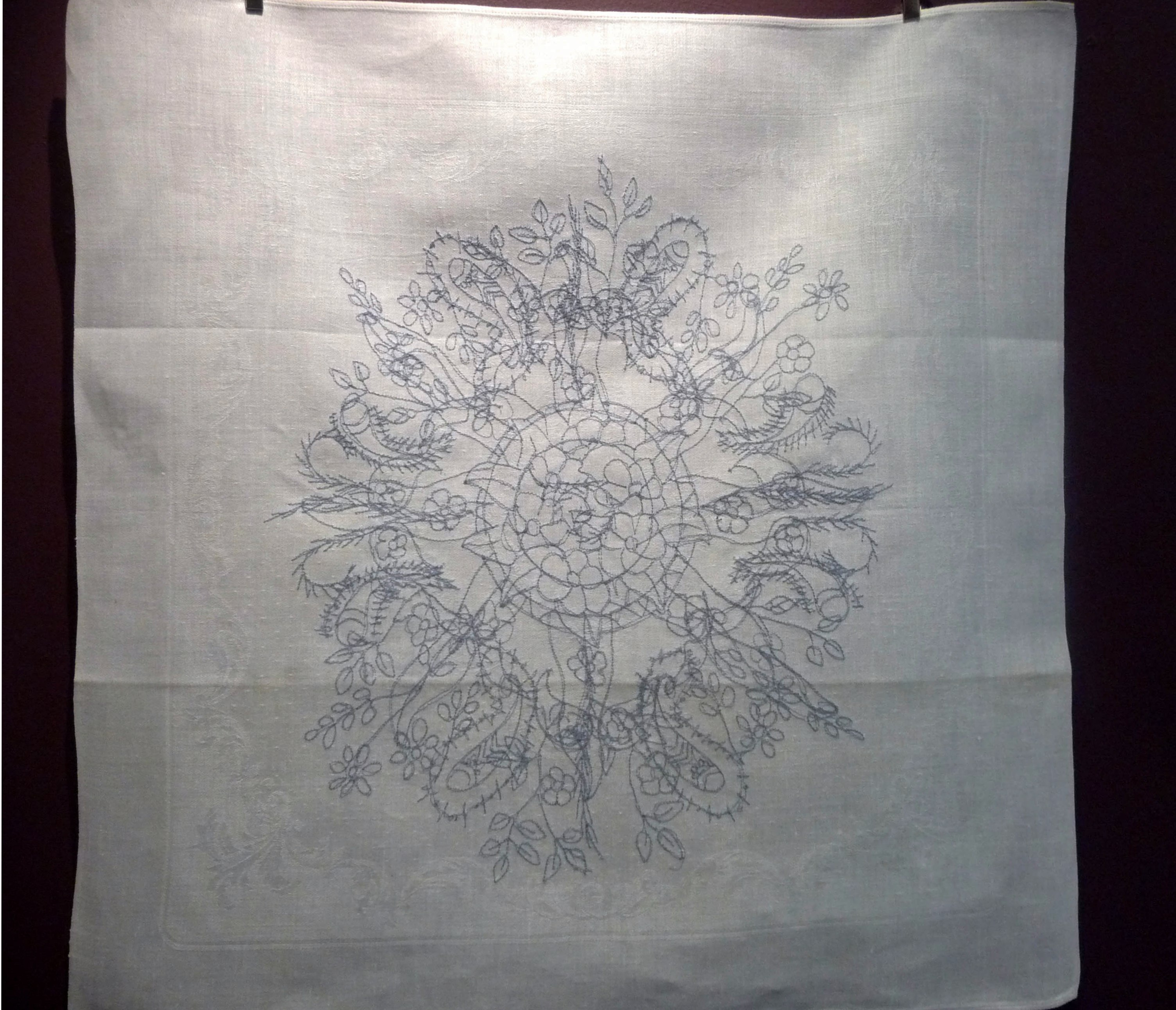 MANDALA FOR THE EARTH 2 by Janet Wilkinson, machine stitch on damask napkin