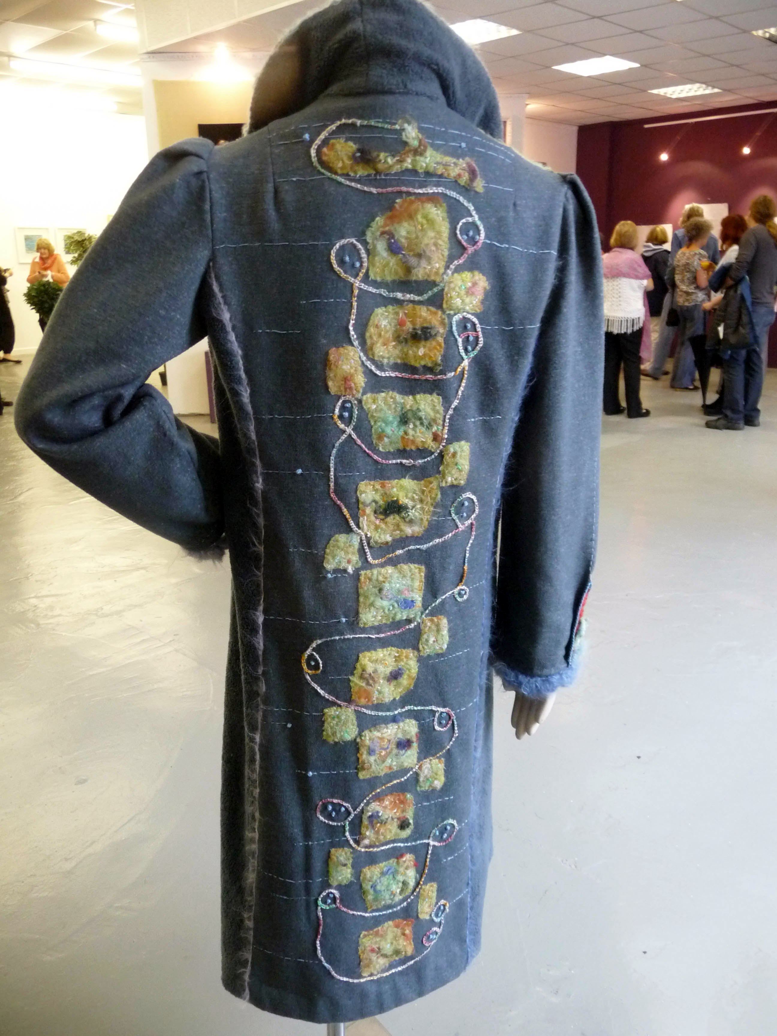 TOUCHING EARTH (COAT) by Yvonne Deegan, felting, machine and hand embroidery (back view)