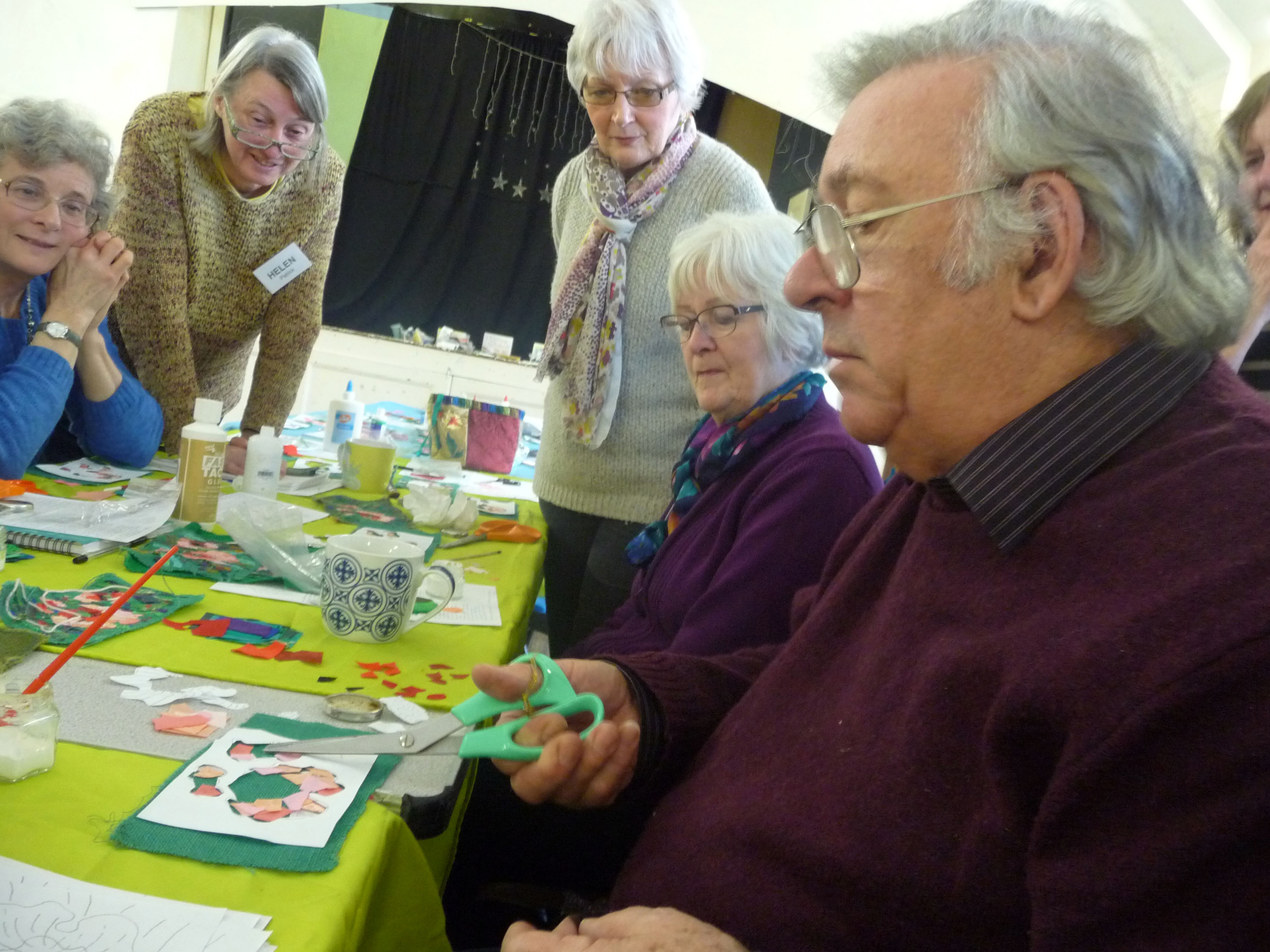 "Richard Box demonstrating how to assemble the flowers at ""Poppies"" workshop at MEG"