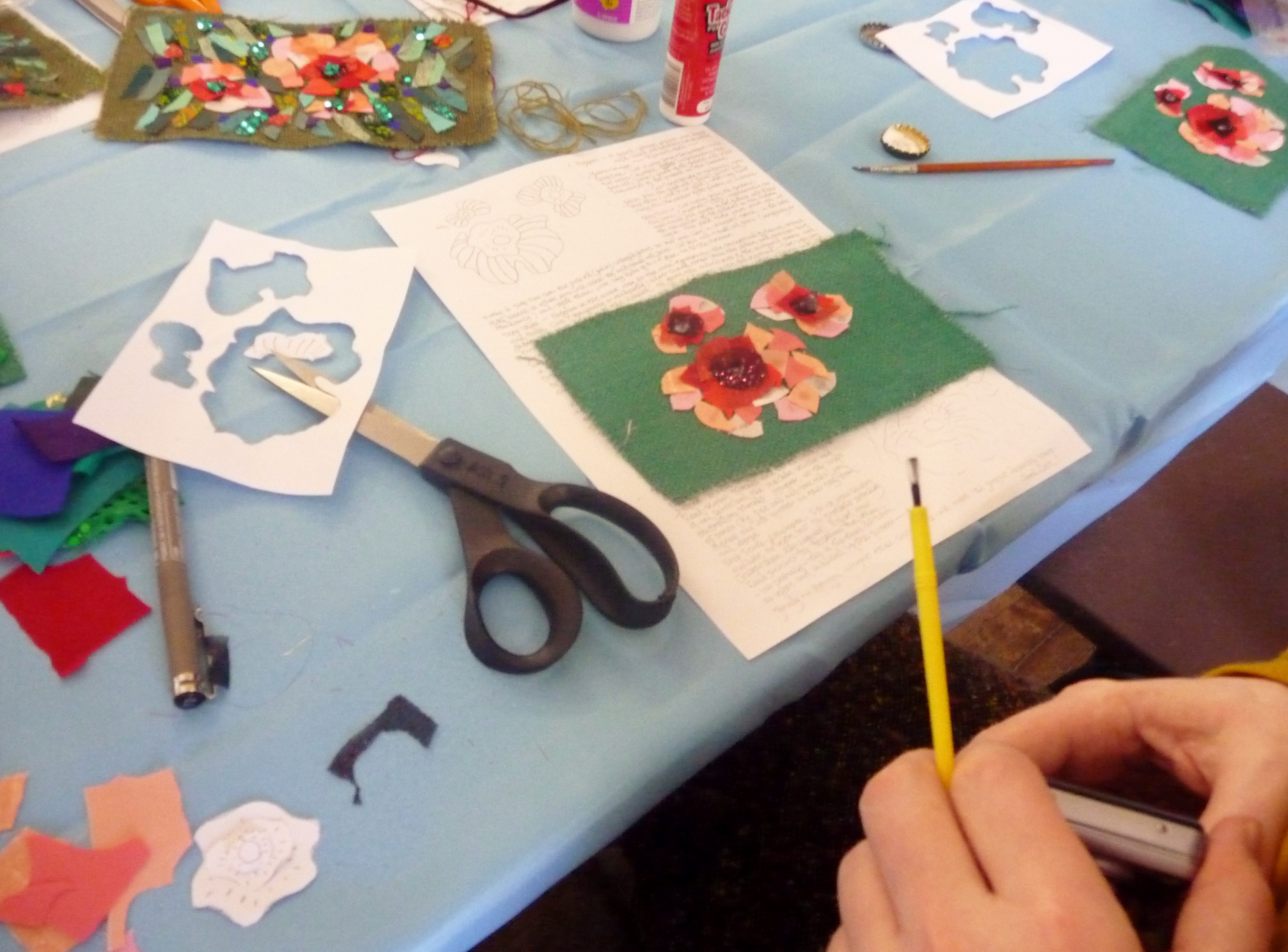 "Richard Box ""Poppies"" workshop at MEG. The flowers are assembled and attached to the background ready for stitching"