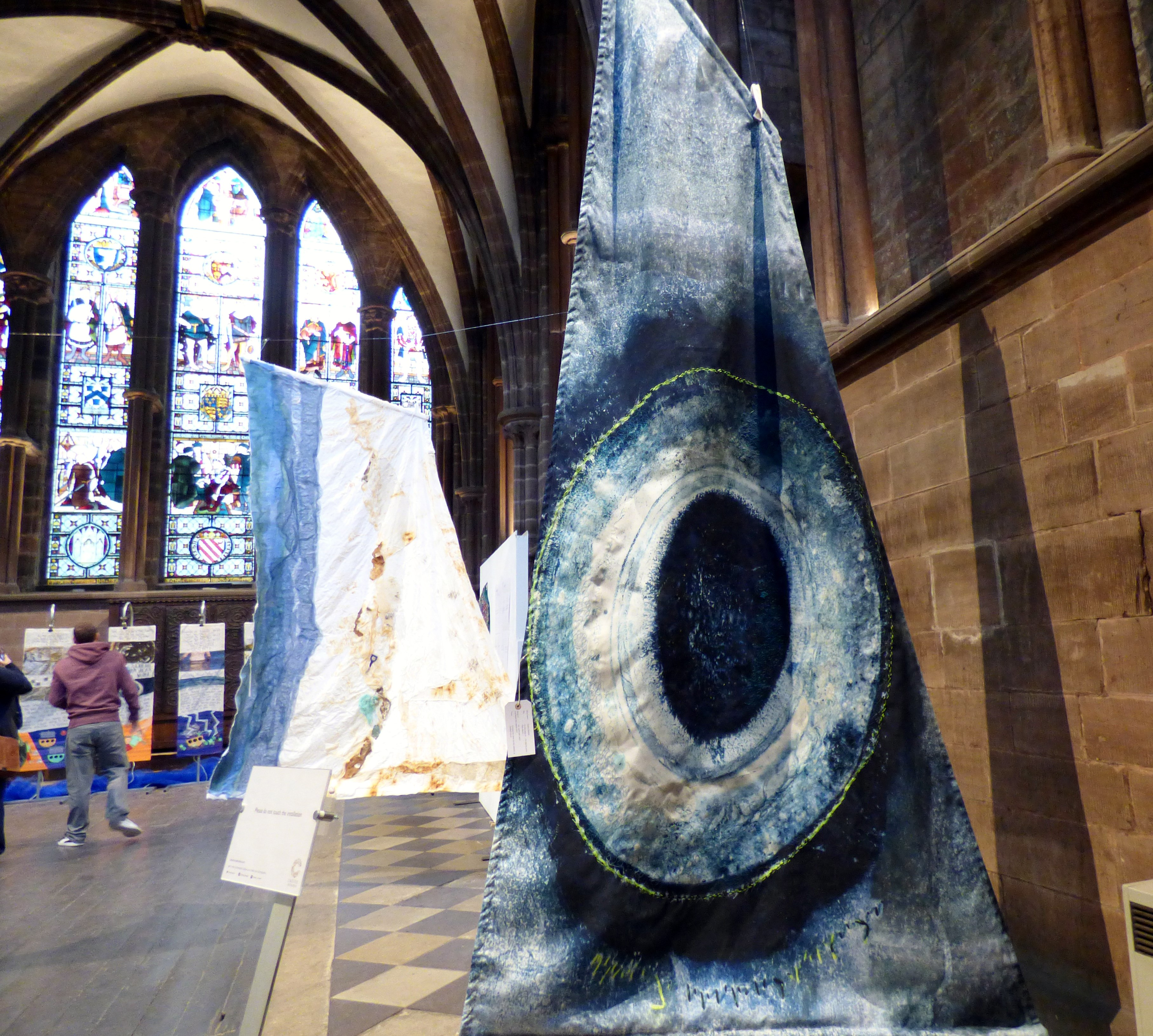ON THE EDGE OF....THE TIPPING POINT by Susan Syddal, ink and paint with stitch translated into digital print, Textile 21, Chester Cathedral 2019