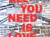ALL YOU NEED IS LOVE by Hilary McCormack, Merseyside branch, reverse applique on newsprint and textile, Rose Bowl competition 2021