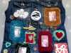 A NOD TO PETER BLAKE, repurposed denim jacket with hand stitching , free machine work and appliqué