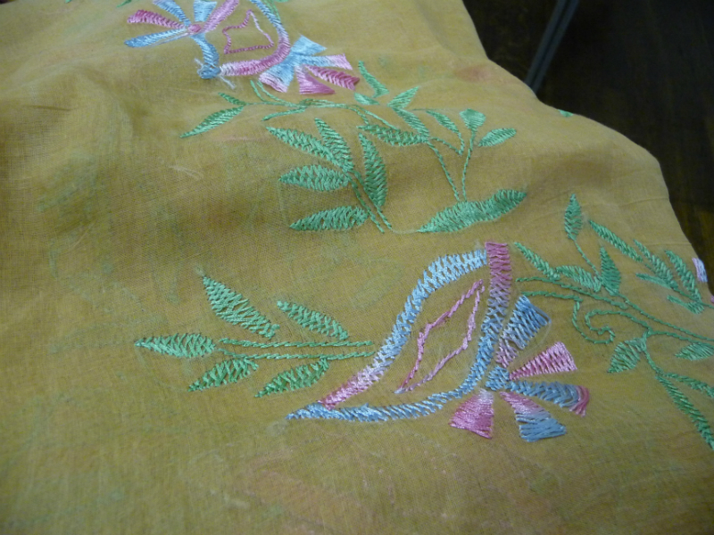 detail of shadow work on a sari