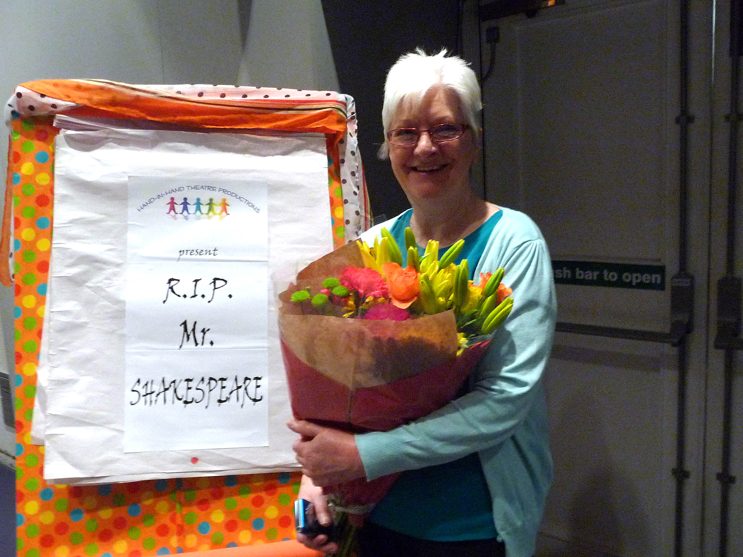 Brenda Muller with flowers presented by Hand in Hand theatre company