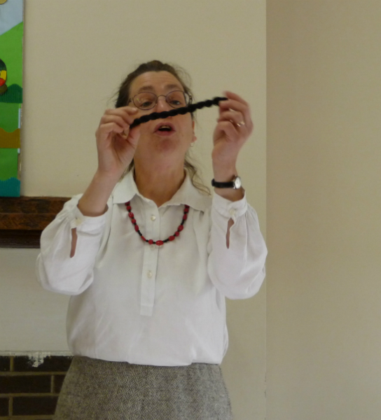 Sarah Thursfield showing us spun thread
