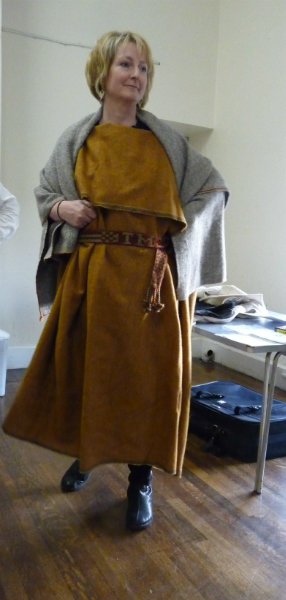Sarah modelling a dress made from a single tube of woolen fabric as worn during Bronze Age
