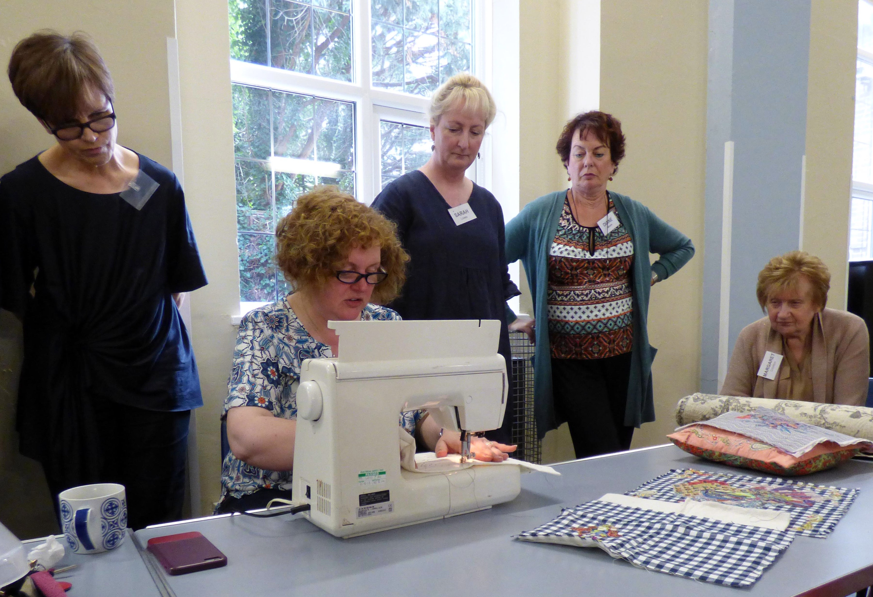 Lizzie Wall demonstrating free machine embroidery at Raw Edge Applique workshop with Lizzie Wall