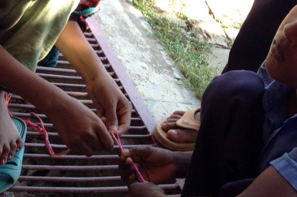 glasses string being woven in Sreepur, Bangladesh
