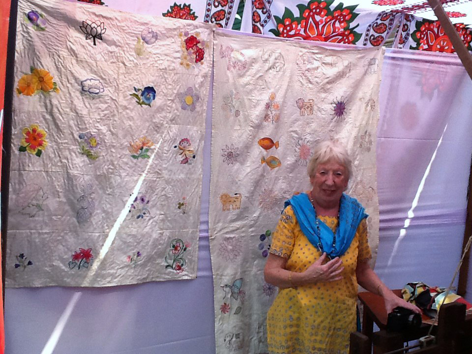 Ruby  with the silk square wall hangings on display at the 25th. Anniversary Celebrations at Sreepur on 9th  February 2014