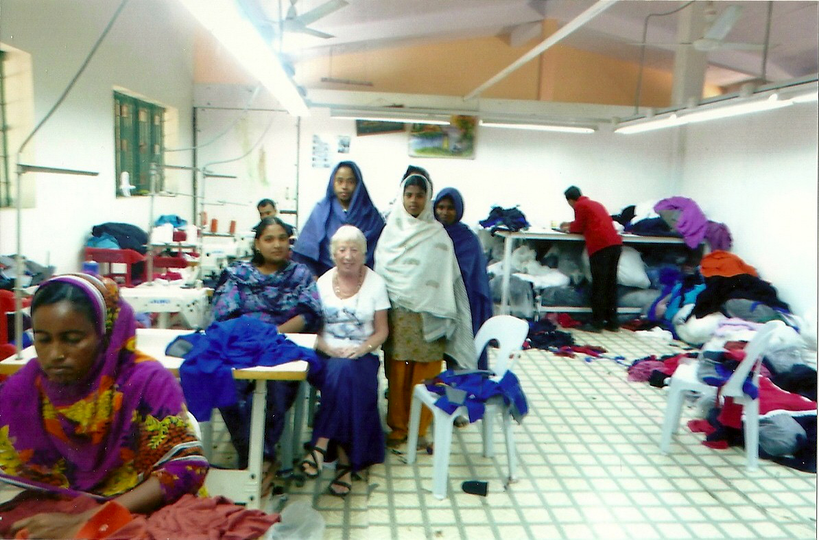 Ruby Porter MBE with the girls in training garment factory, Sreepur, Bangladesh 2014