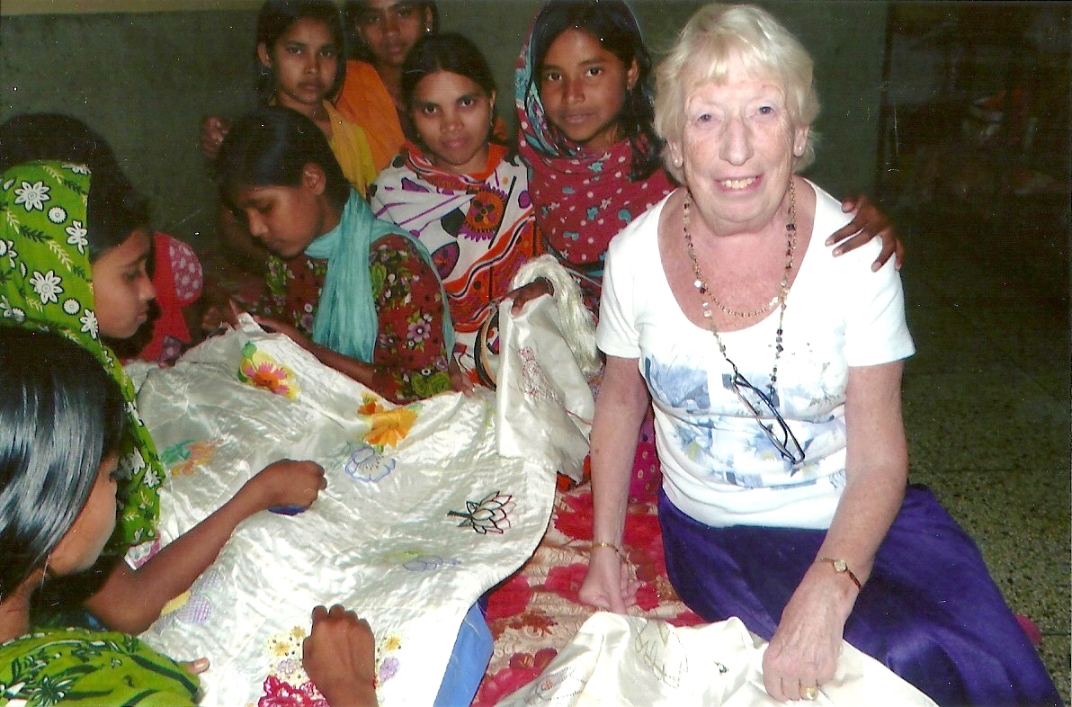 girls of Sreepur Village are stitching the background to the Flower Quilt 2014