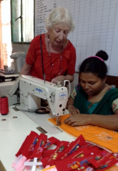 This is Parul in Sreepur Bangladesh, who is sewing on an industrial machine that Ruby had adapted for her