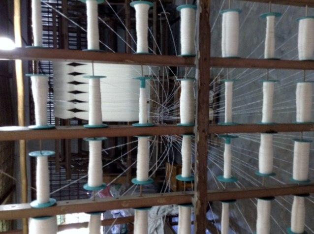 spinning cotton for new design scarves in Sreepur, Bangladesh
