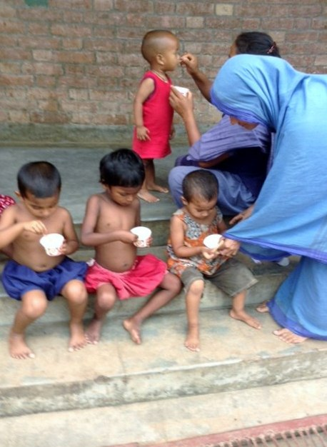 some of the children who live in Sreepur Village are enjoying ice cream - a rare treat!